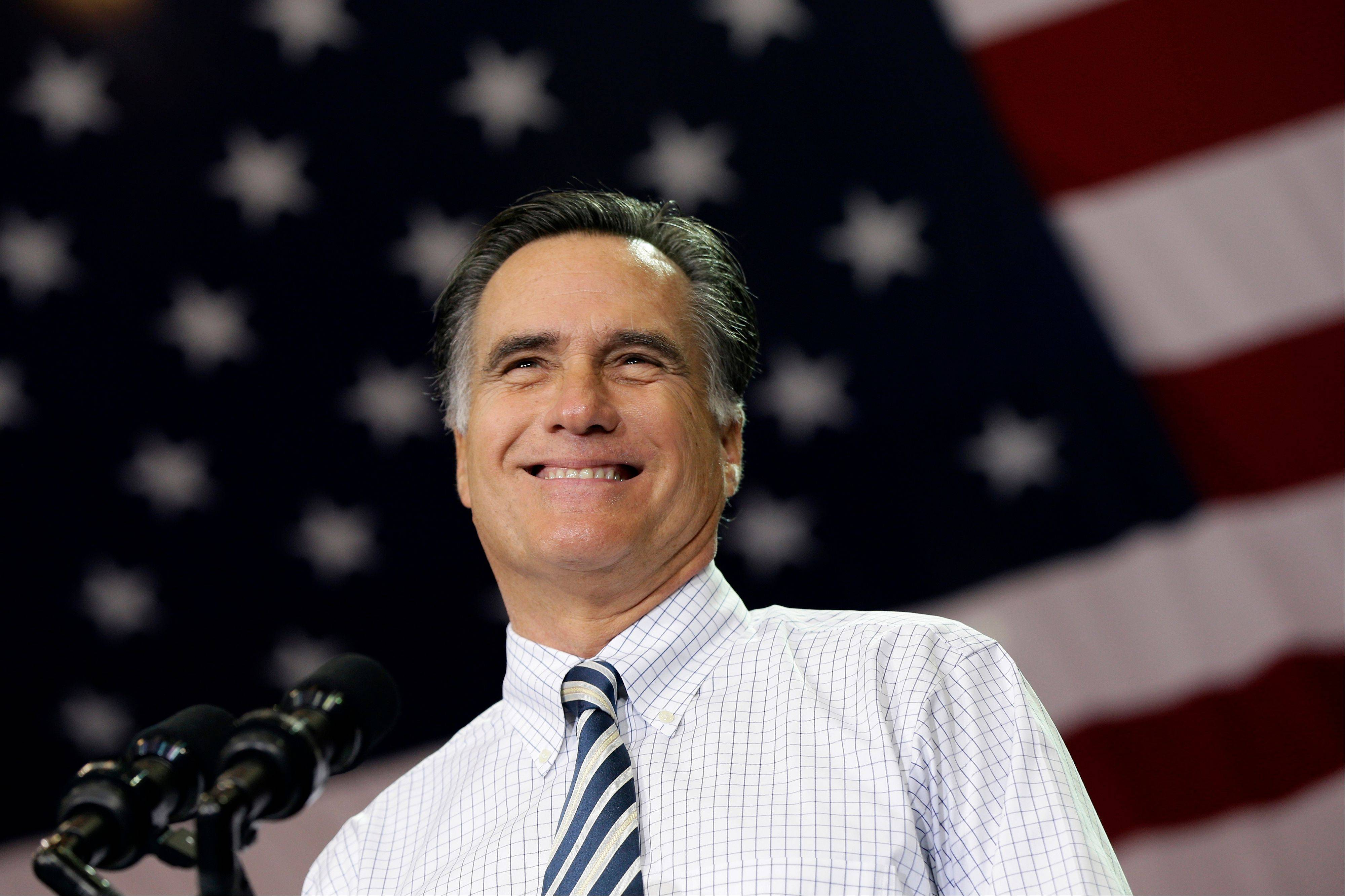 Republican presidential candidate and former Massachusetts Gov. Mitt Romney smiles as he campaigns at the International Exposition Center in Cleveland on Sunday.