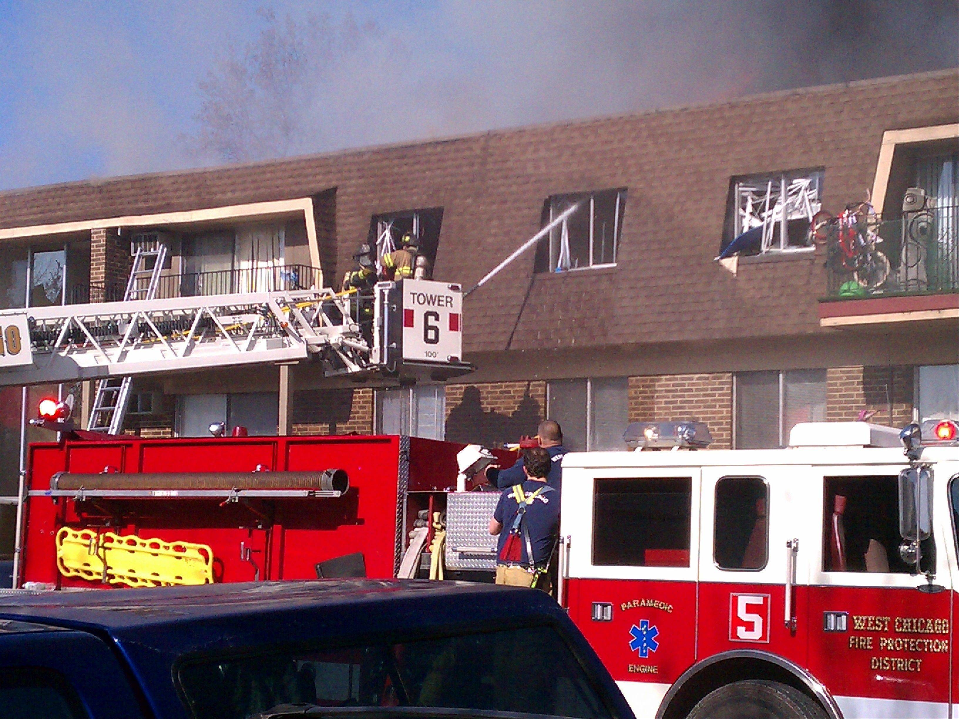 Firefighters from West Chicago and neighboring departments were on the scene of an extra-alarm blaze that swept through a three-story apartment building Sunday morning. The fire left many residents temporarily homeless, but all escaped unharmed.