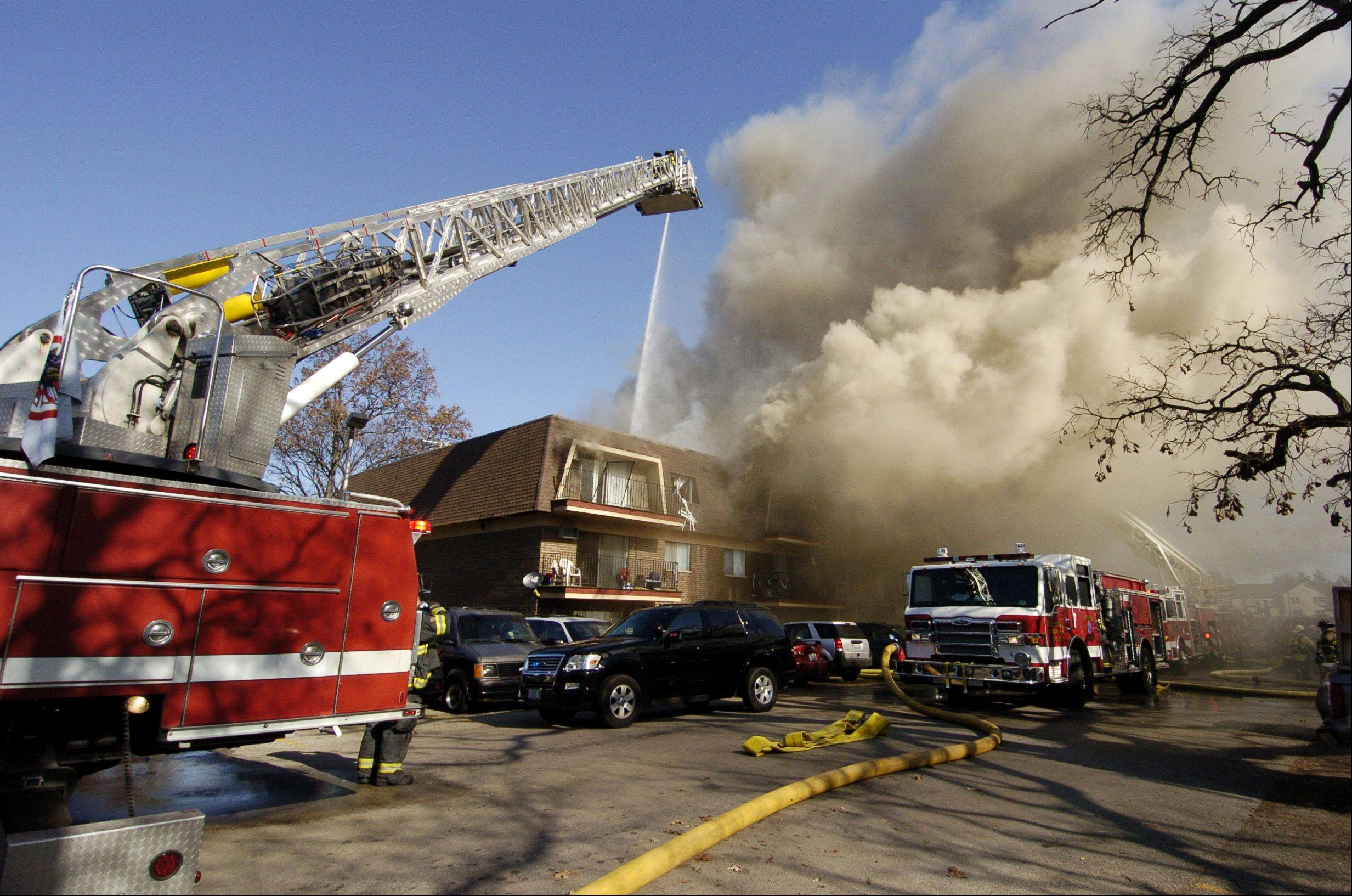 Multiple fire departments worked to extinguish a fire at an apartment building Sunday in the 1200 block of Kings Circle in West Chicago. The fire left many residents temporarily homeless, but all escaped unharmed.