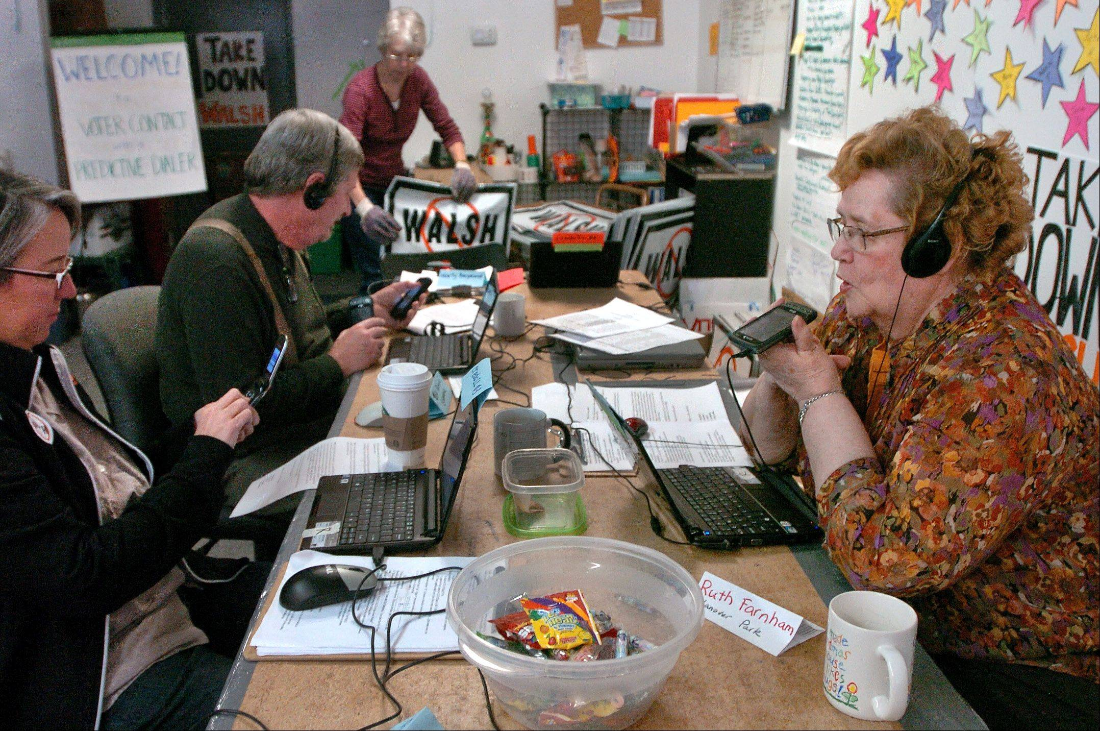 "Still involved in the political process at age Ruth 79, Farnham of Hanover Park, right, works the phones in this Elk Grove Village office of the CREDO SuperPAC. Her husband, Willis ""Bill"" Farnham, is 91 and a very active precinct captain."