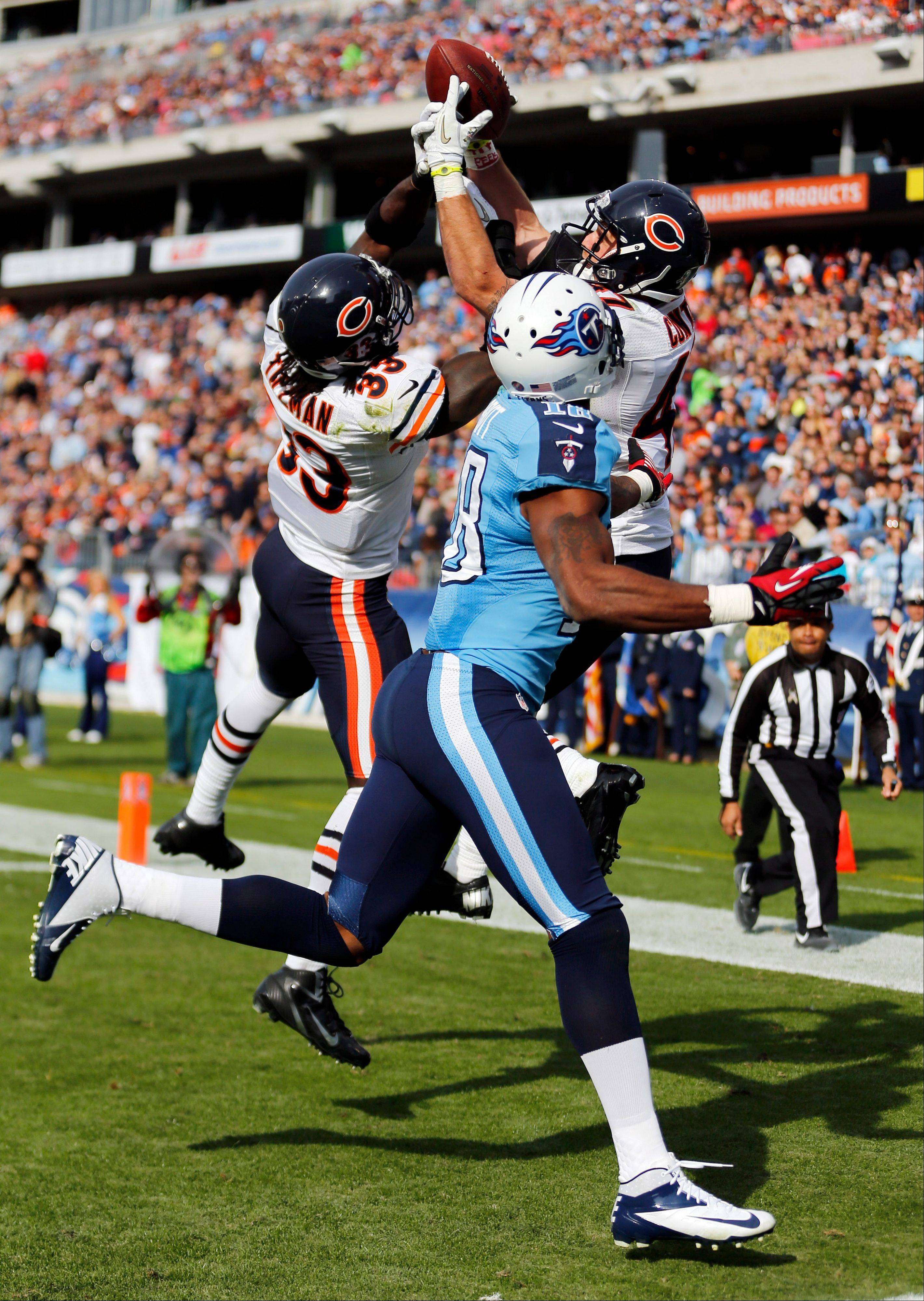 Charles Tillman, left, and Chris Conte break up a pass in the end zone intended for Titans wide receiver Kenny Britt in the second quarter Sunday.