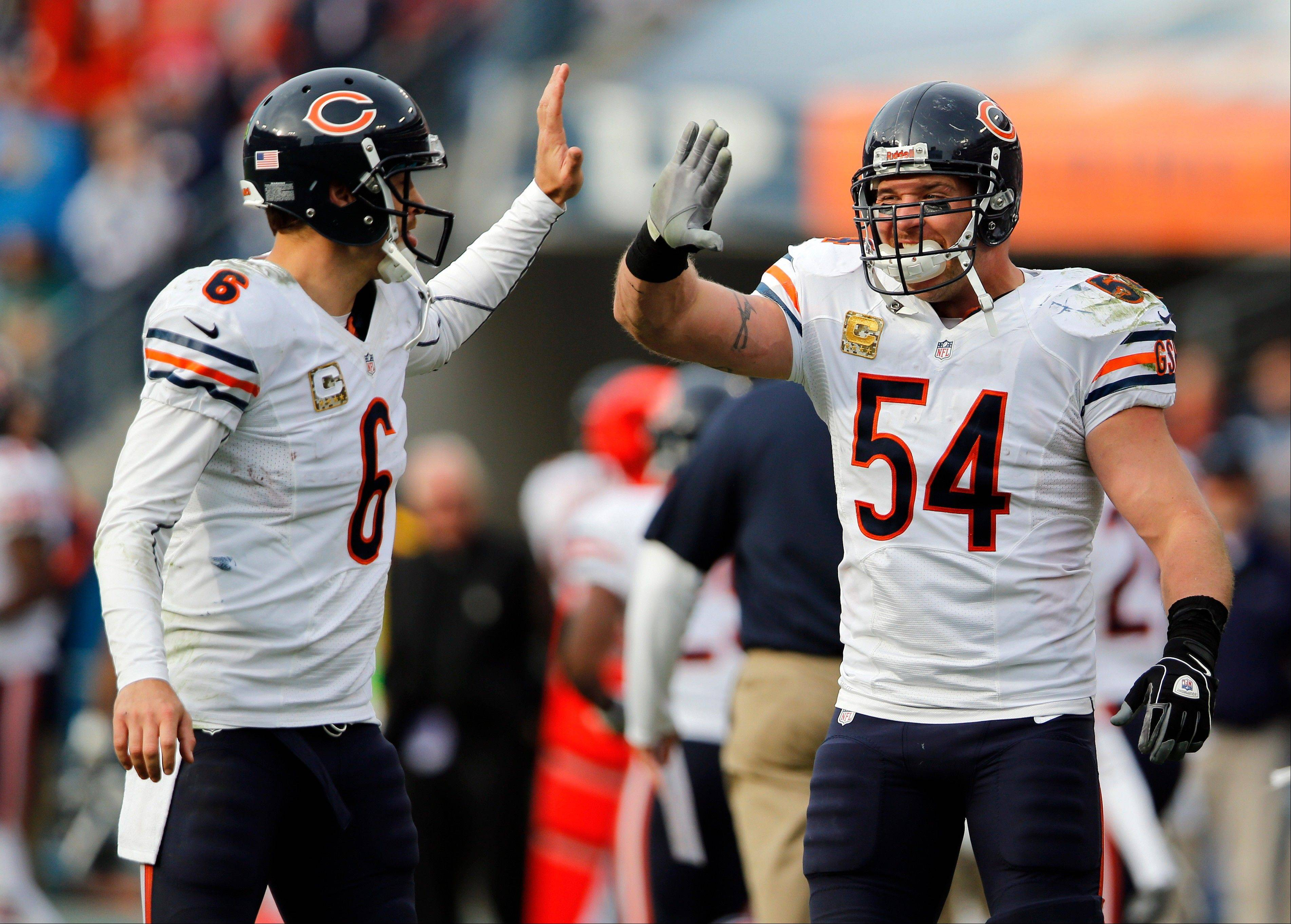 Bears quarterback Jay Cutler, left, and linebacker Brian Urlacher had plenty to celebrate during Sunday's rout of the Titans.