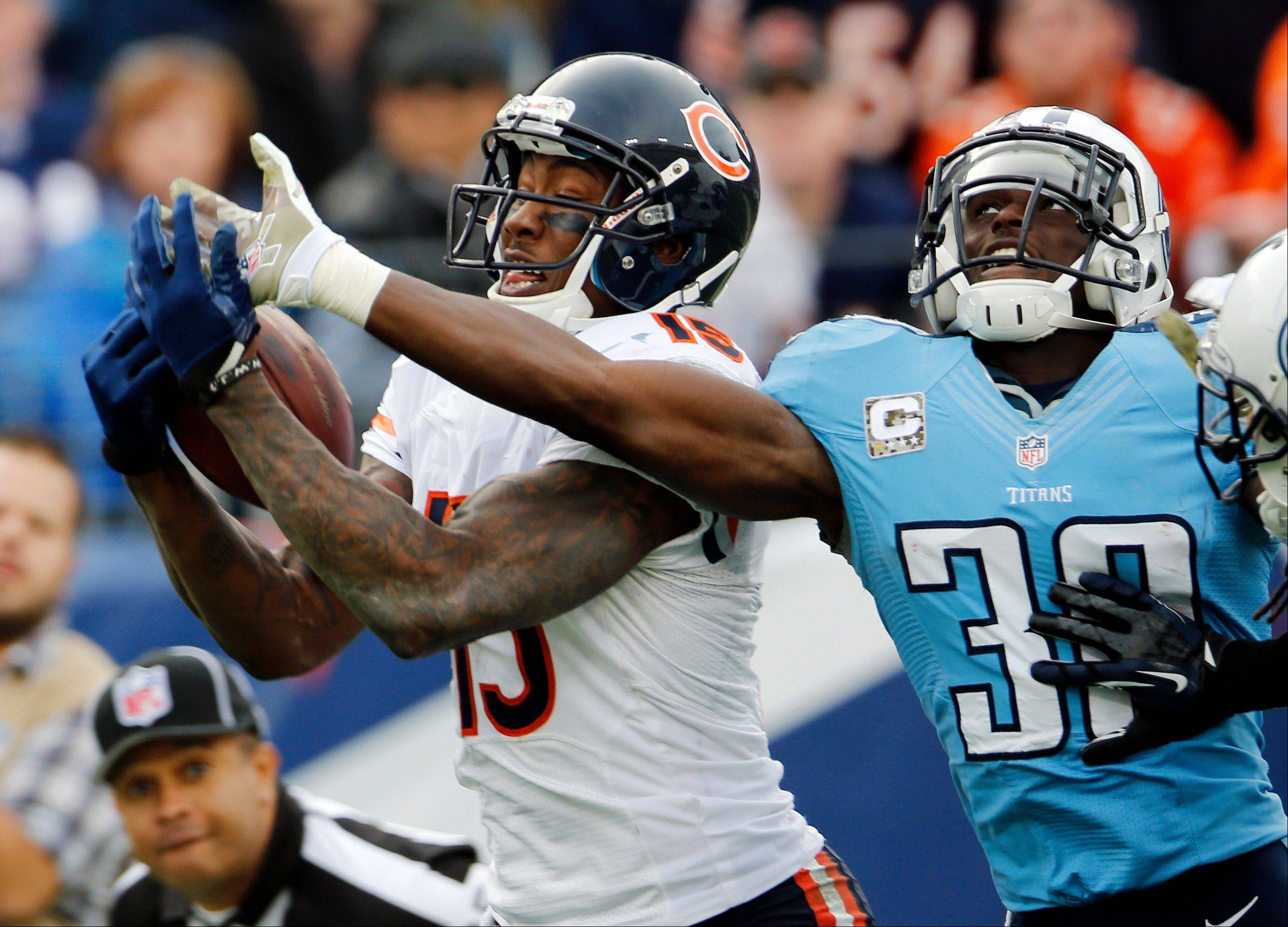 Chicago Bears wide receiver Brandon Marshall catches a 39-yard touchdown pass ahead of Tennessee Titans cornerback Jason McCourty in the fourth quarter. The Bears beat the Titans 51-20.