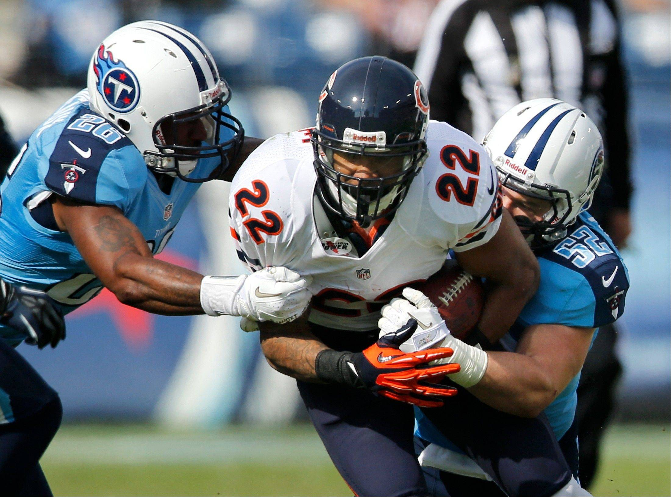 Chicago Bears running back Matt Forte is stopped by Tennessee Titans defenders Jordan Babineaux and Colin McCarthy in the first quarter.