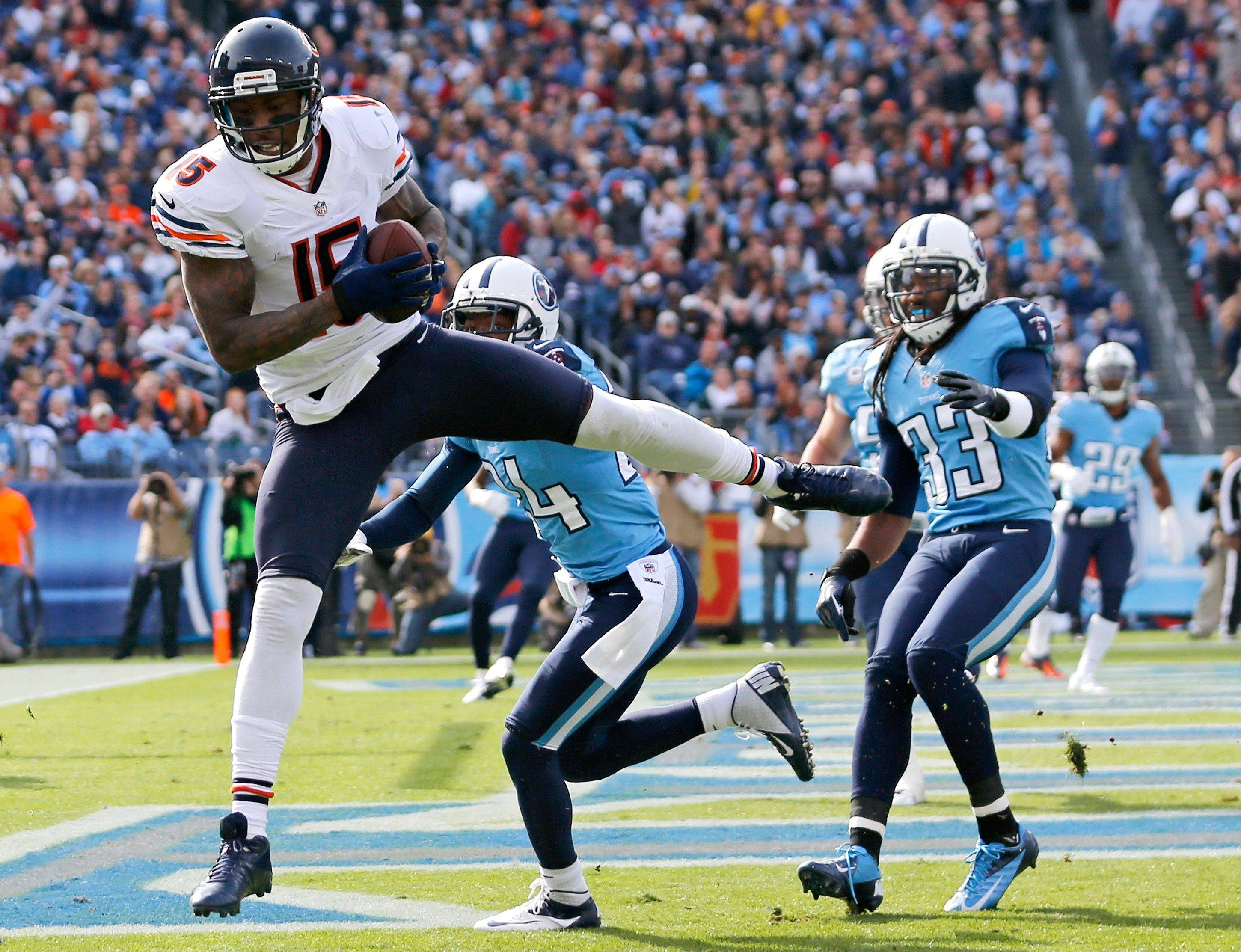 Chicago Bears wide receiver Brandon Marshall catches a 13-yard touchdown pass as he is defended by Tennessee Titans cornerback Coty Sensabaugh and safety Michael Griffin in the first quarter.
