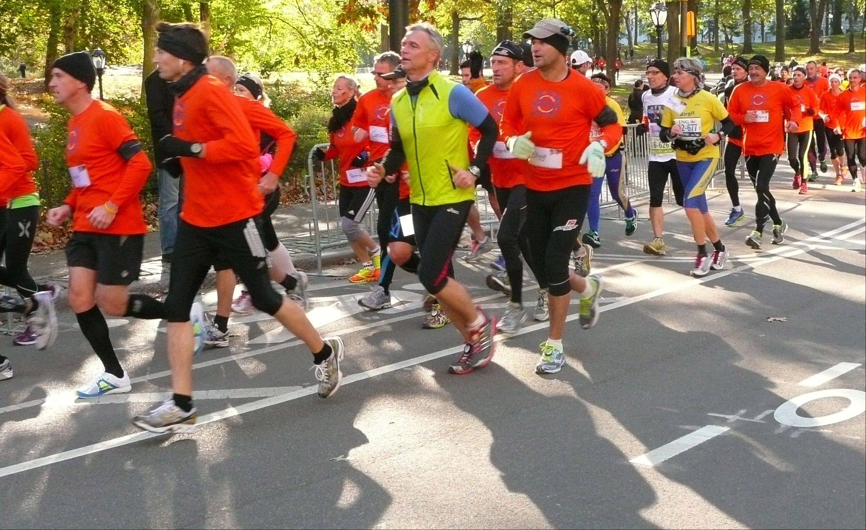 Runners who were planning to participate in the New York City Marathon run through Central Park in Manhattan in an alternative marathon Sunday in New York.