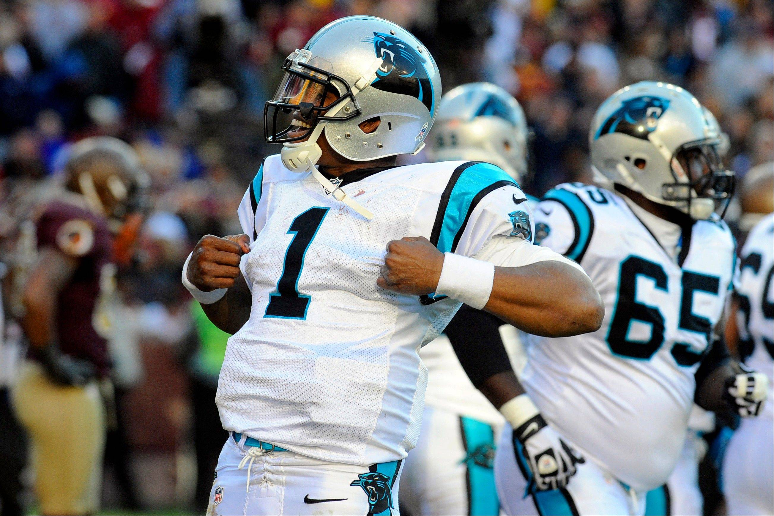 Carolina Panthers quarterback Cam Newton celebrates after his touchdown during the second half against the Washington Redskins on Sunday in Landover, Md.