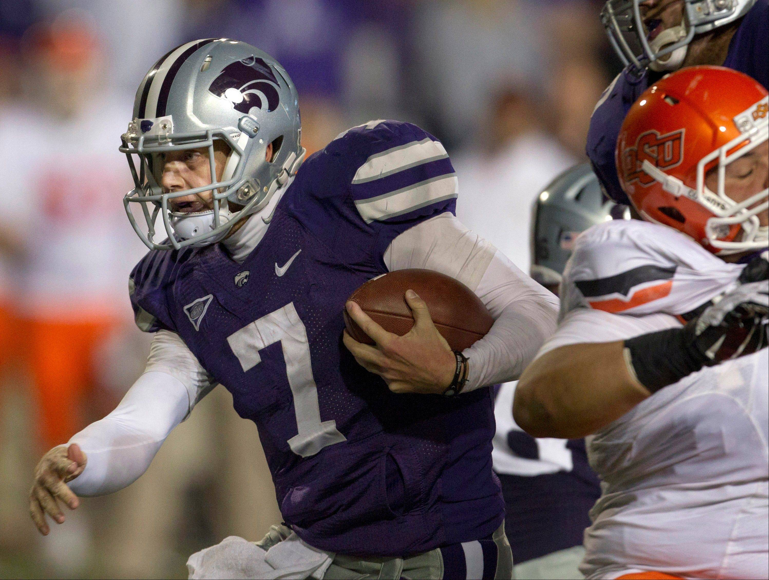 Kansas State quarterback Collin Klein runs for a first down Saturday during the first half against Oklahoma State in Manhattan, Kan.
