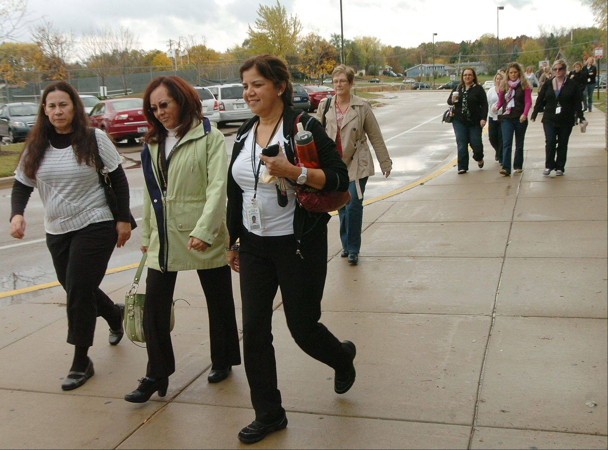 Teachers in Community Unit District 300 arrive at Dundee-Crown High School to vote on strike action Oct. 14. While the teachers union declared an impasse Monday, several things taking weeks still must happen before teachers could actually walk out.