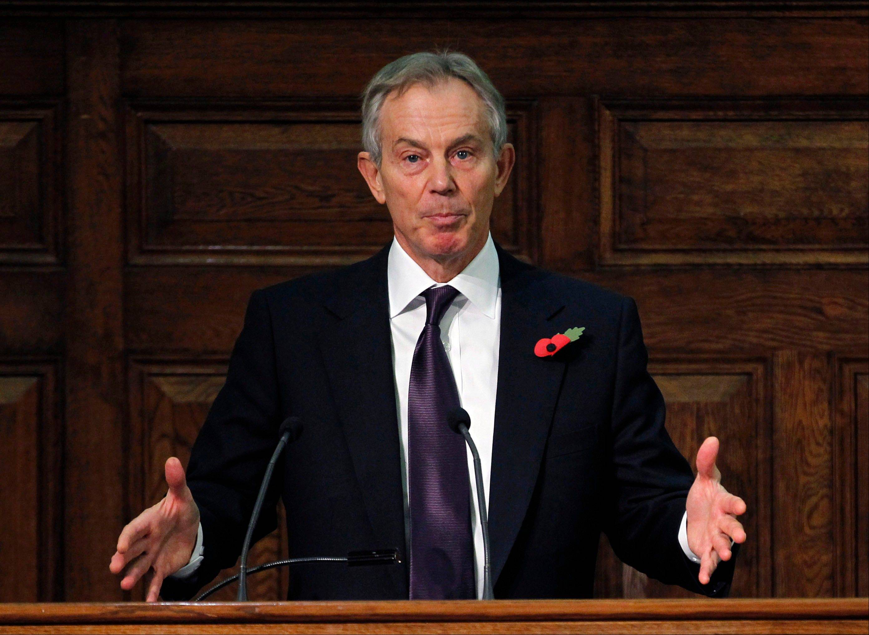 Former British Prime Minister Tony Blair addresses the delegates at the Iraq Britain Business Council's fourth annual conference in central London Monday. Blair says British forces should be proud of their role in the U.S.-led invasion of Iraq, citing what he claimed is major progress made in the country since the toppling of Saddam Hussein in 2003.