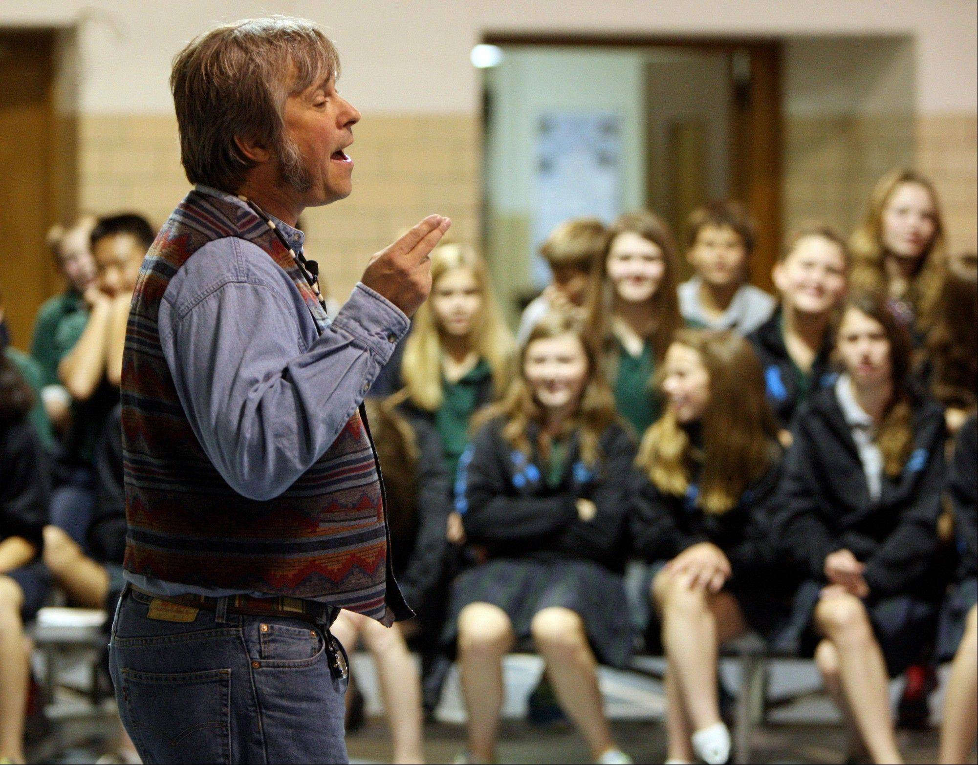 "Storyteller Brian ""Fox"" Ellis, of Peoria performs for students at St. Mary's Middle School in Alton. The school continues segregating students by sex in all but two courses, continuing an experiment it started last semester."