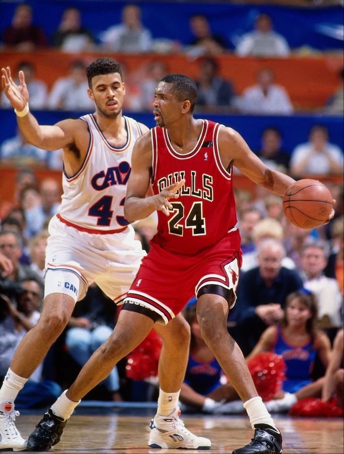 Bill Cartwright (No. 24) of the Chicago Bulls dribbles against Brad Daugherty (No. 43) of the Cleveland Cavaliers in this 1991 file photo at the Richfield Coliseum in Richfield, Ohio.
