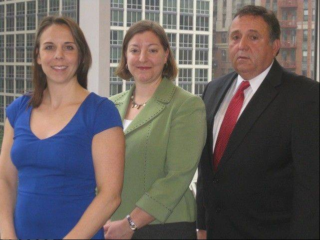 Gina Gruss Romagnoli, from left, Kristin M. Gruss and Henry Phillip Gruss lead the Henry Phillip Gruss Ltd. law firm in Park Ridge.
