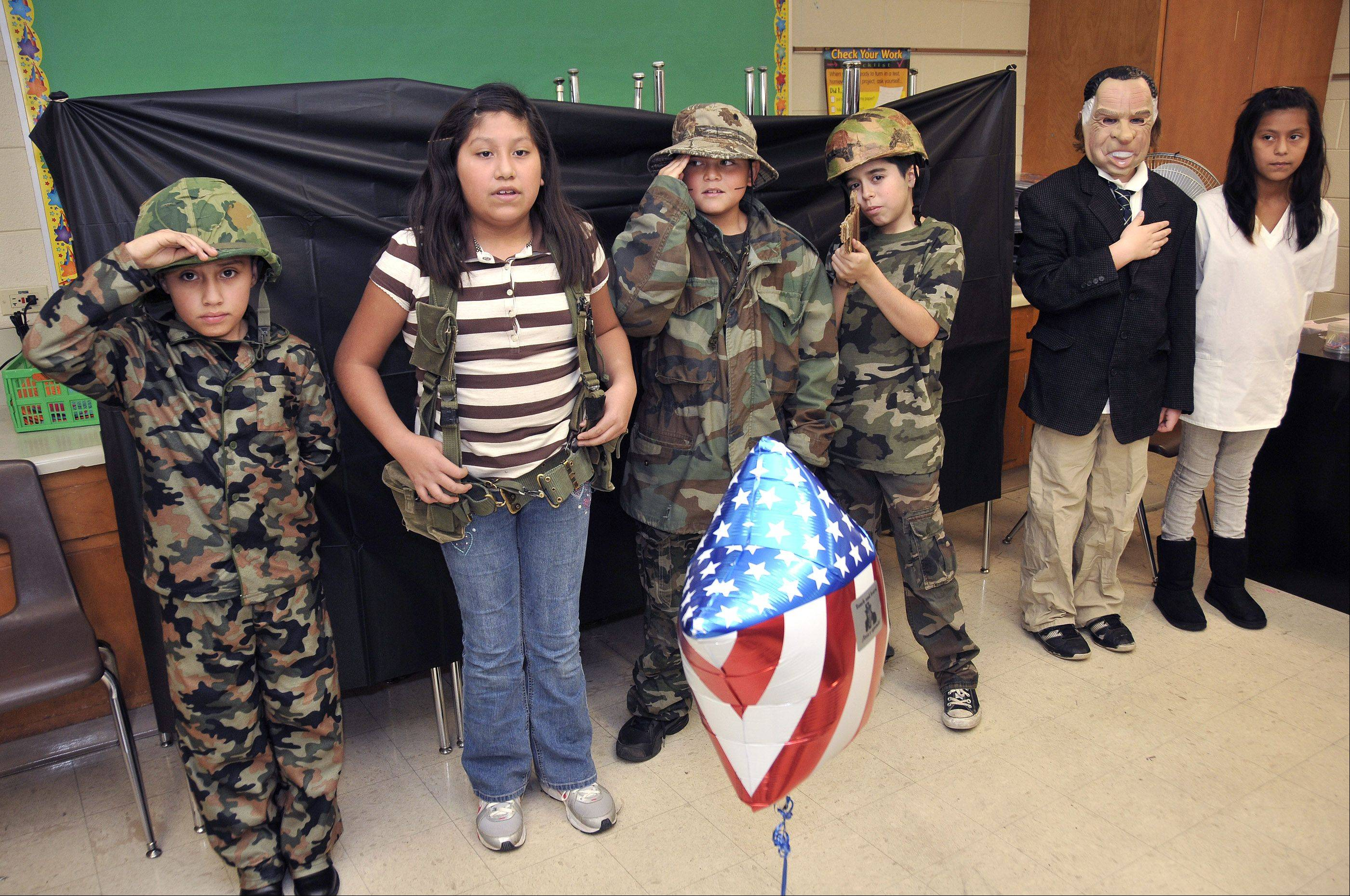 Making a presentation on the Vietnam War are, from left, Jose Rubio, Faviola Cielo, Alonso Salinas, Brandon, Garcia, Nathan Bradley as Richard Nixon, and Guadalupe Carrera.