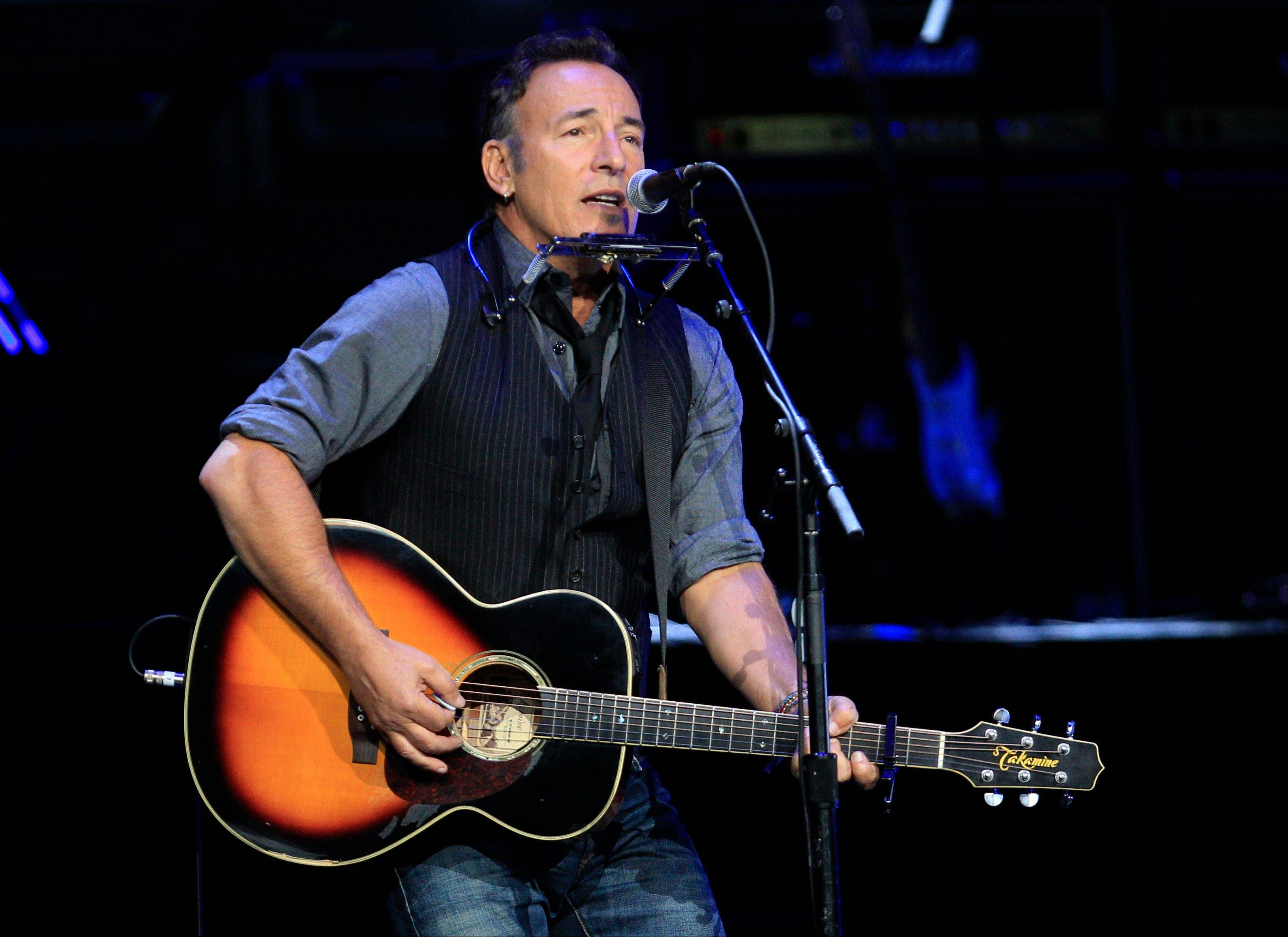 Singer Bruce Springsteen performs at a campaign event for President Barack Obama at Nationwide Arena Monday in Columbus, Ohio.