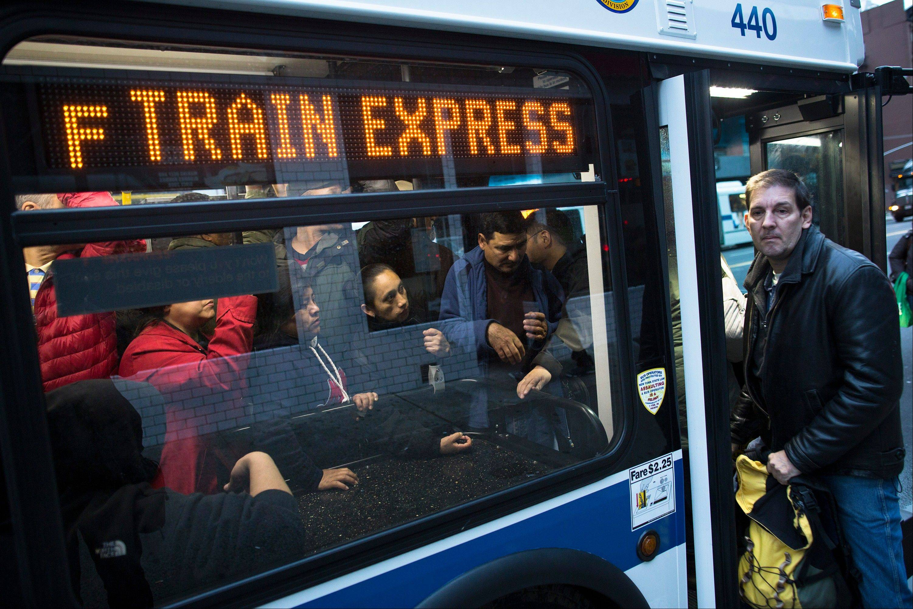 A passenger is turned away Friday from an overcrowded bus in New York intended to help ferry commuters as subway systems below 34th Street remain offline due to Superstorm Sandy.