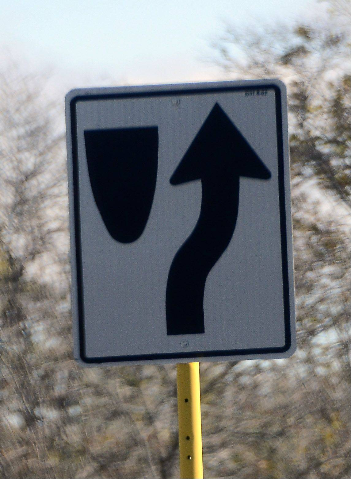 Keep right: The arrow on this sign tells you where to drive when you approach traffic islands or medians.