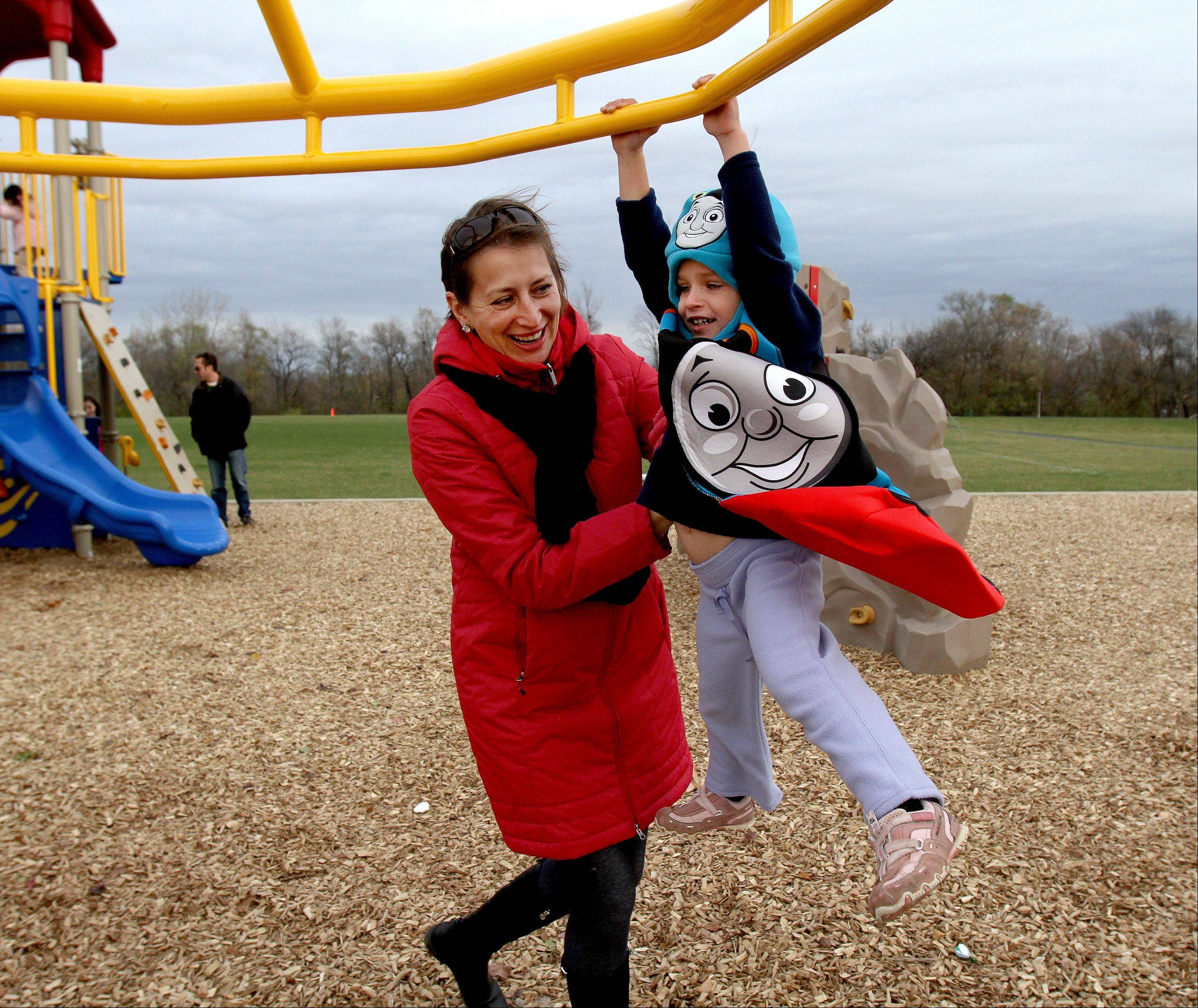 Katia Noti and her daughter Fay, 3, of Roselle, check out the new playground during a grand opening at the Clauss Recreation Center in Roselle on Tuesday.