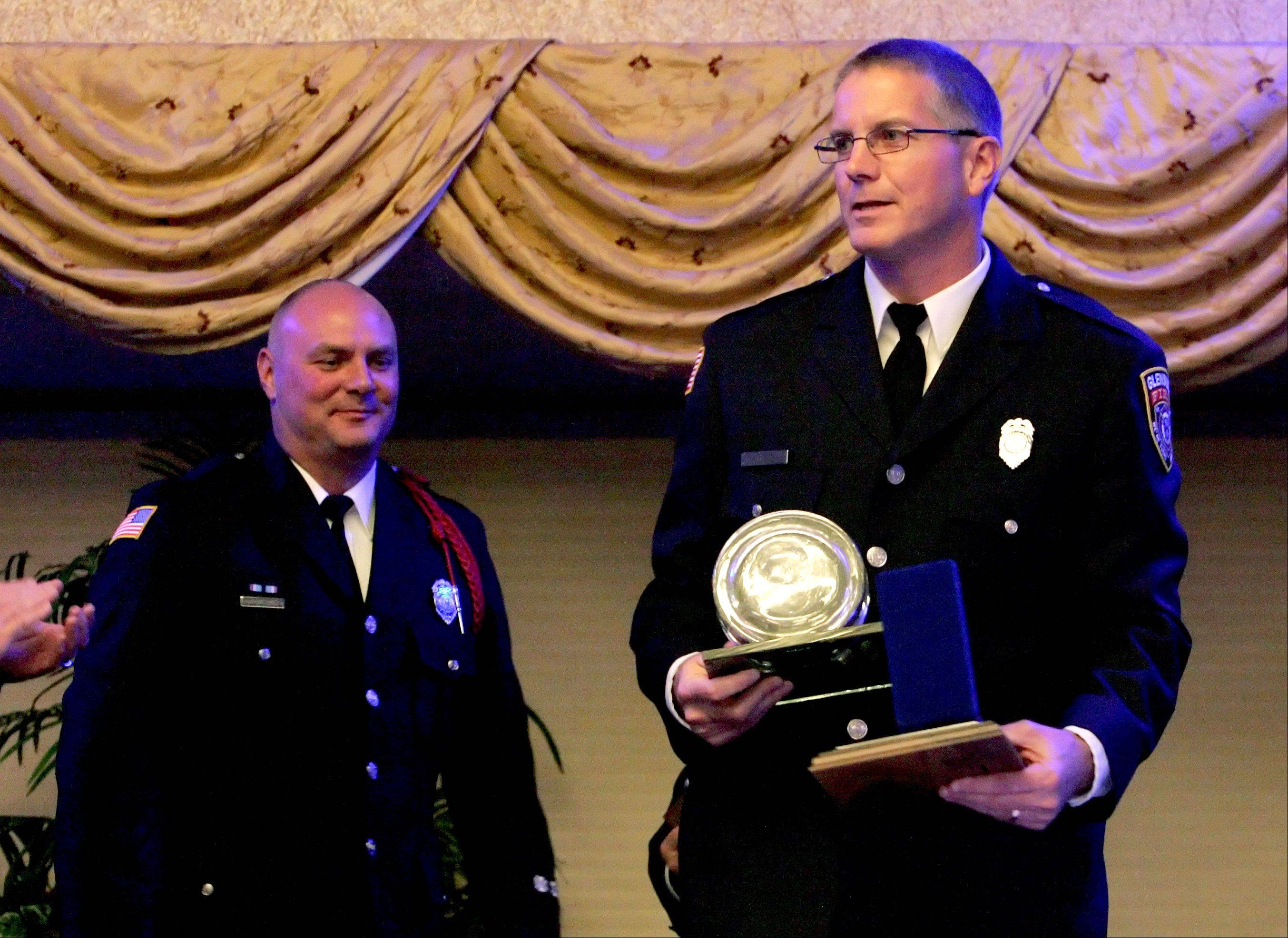 Christopher Wallin, left and Michael Small, right, firefighters with Glenside Fire Protection District accept their Awards of Valor from the Hundred Club of DuPage County.