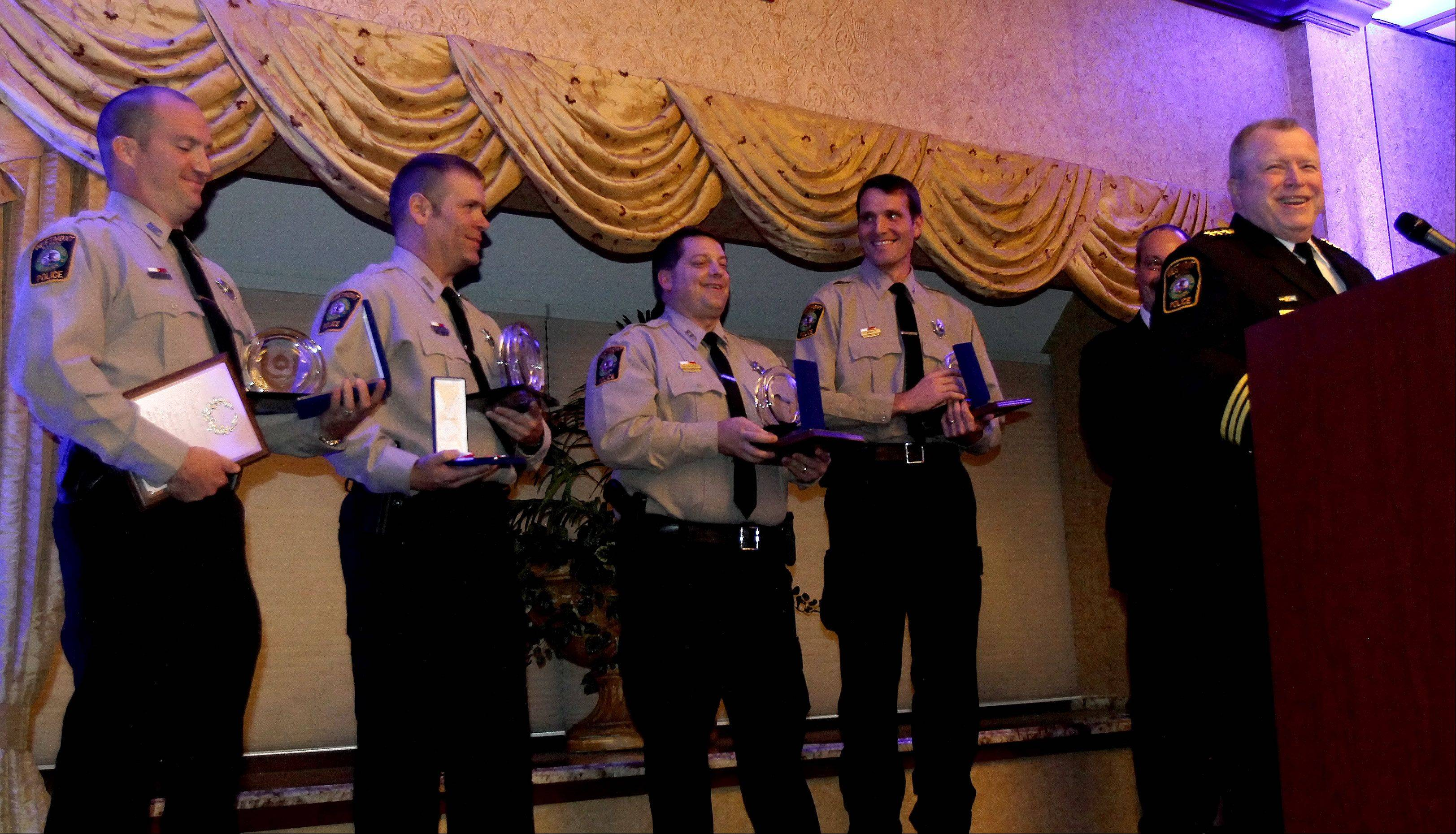 Left to right are Officers Gregory Hausner, John Majeski, Sean Ryan and David Hamblin with the Westmont Police Department, accept their Awards of Valor from the Hundred Club of DuPage County.