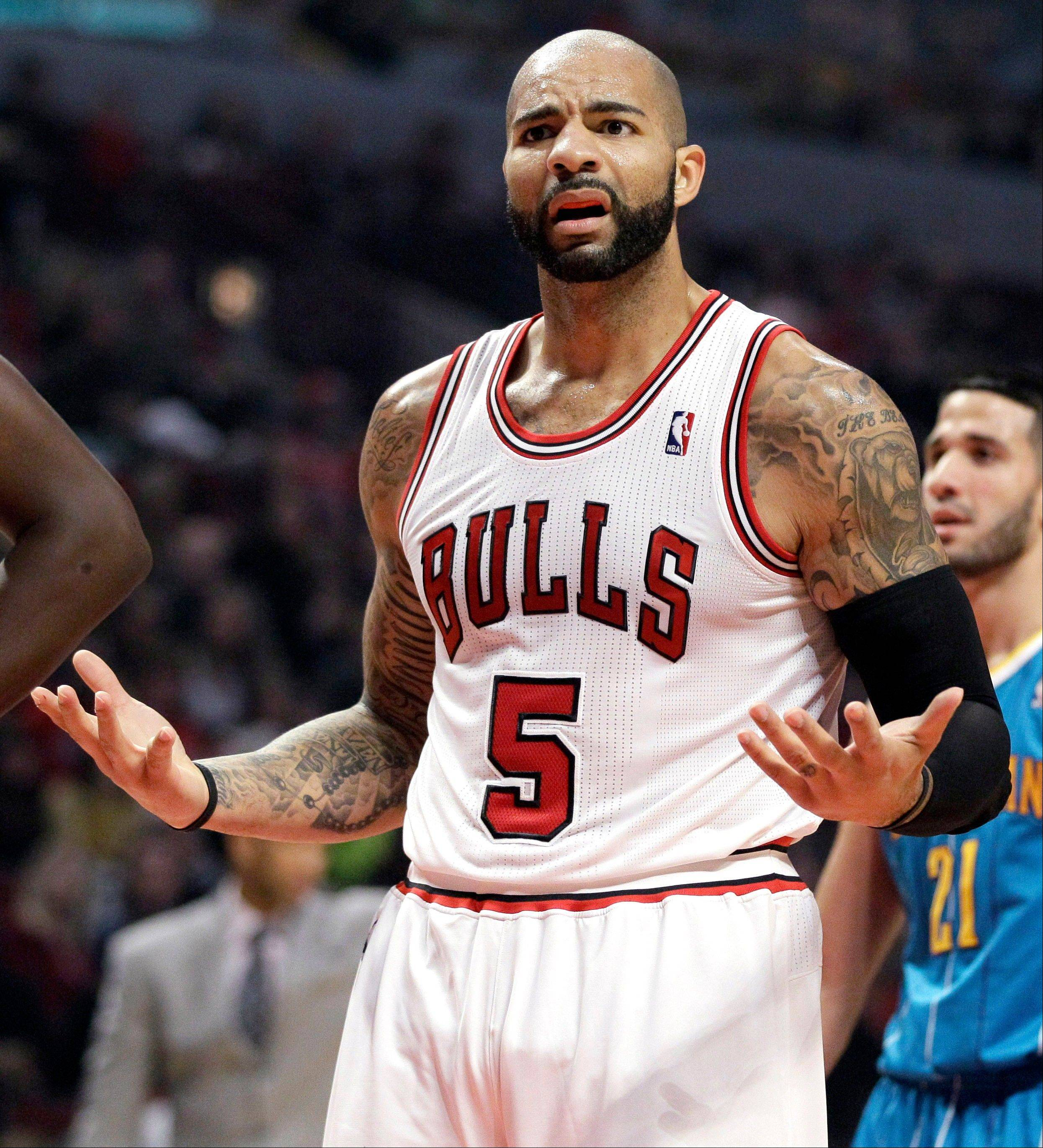 Forward Carlos Boozer is just one of several Bulls who will have to rescue the team late in close games while Derrick Rose's knee mends.