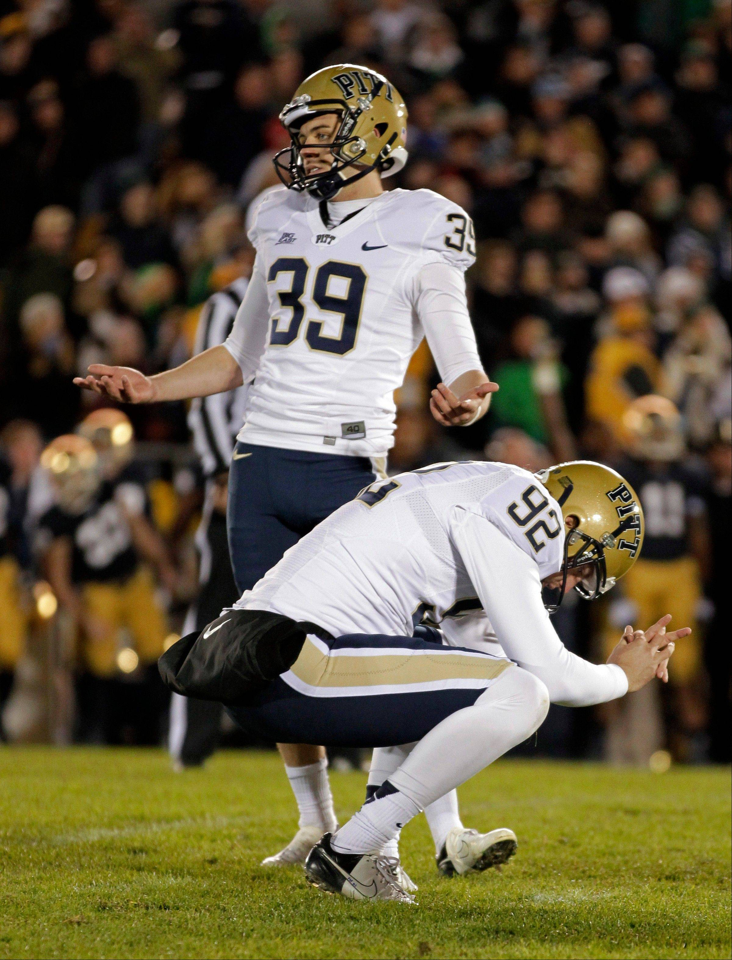 Pittsburgh kicker Kevin Harper (39) and holder Matt Yoklic react after Harper missed what would have been the game-winning field goal in the second overtime period Saturday against Notre Dame. Notre Dame defeated Pittsburgh 29-26 in triple overtime.