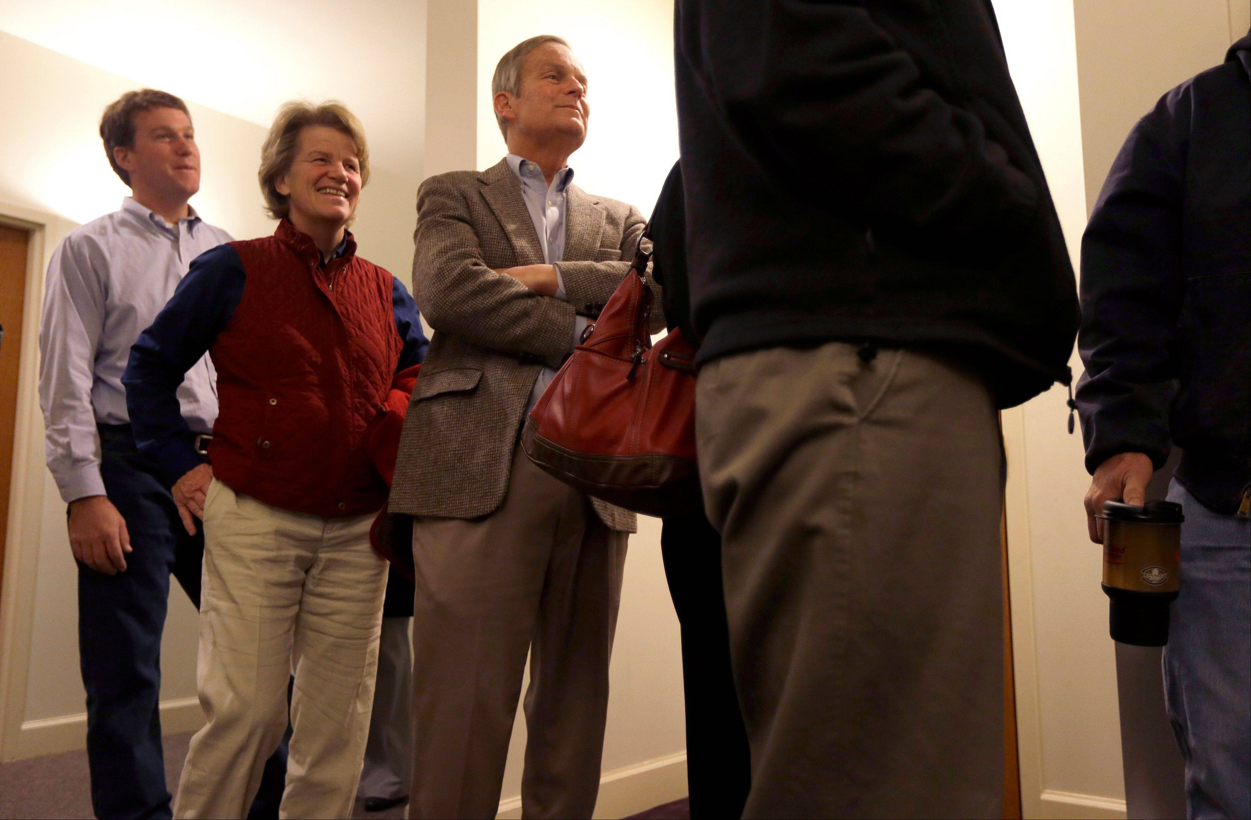 Missouri U.S. Senate candidate, Rep. Todd Akin, R-Mo., center, waits in line to vote along with his wife Lulli, center left,, and son Wynn, left, at their polling place, Star Bridge Christian Center, Tuesday, Nov. 6, 2012, in Wildwood, Mo. Akin is running against incumbent Sen. Claire McCaskill, D-Mo.