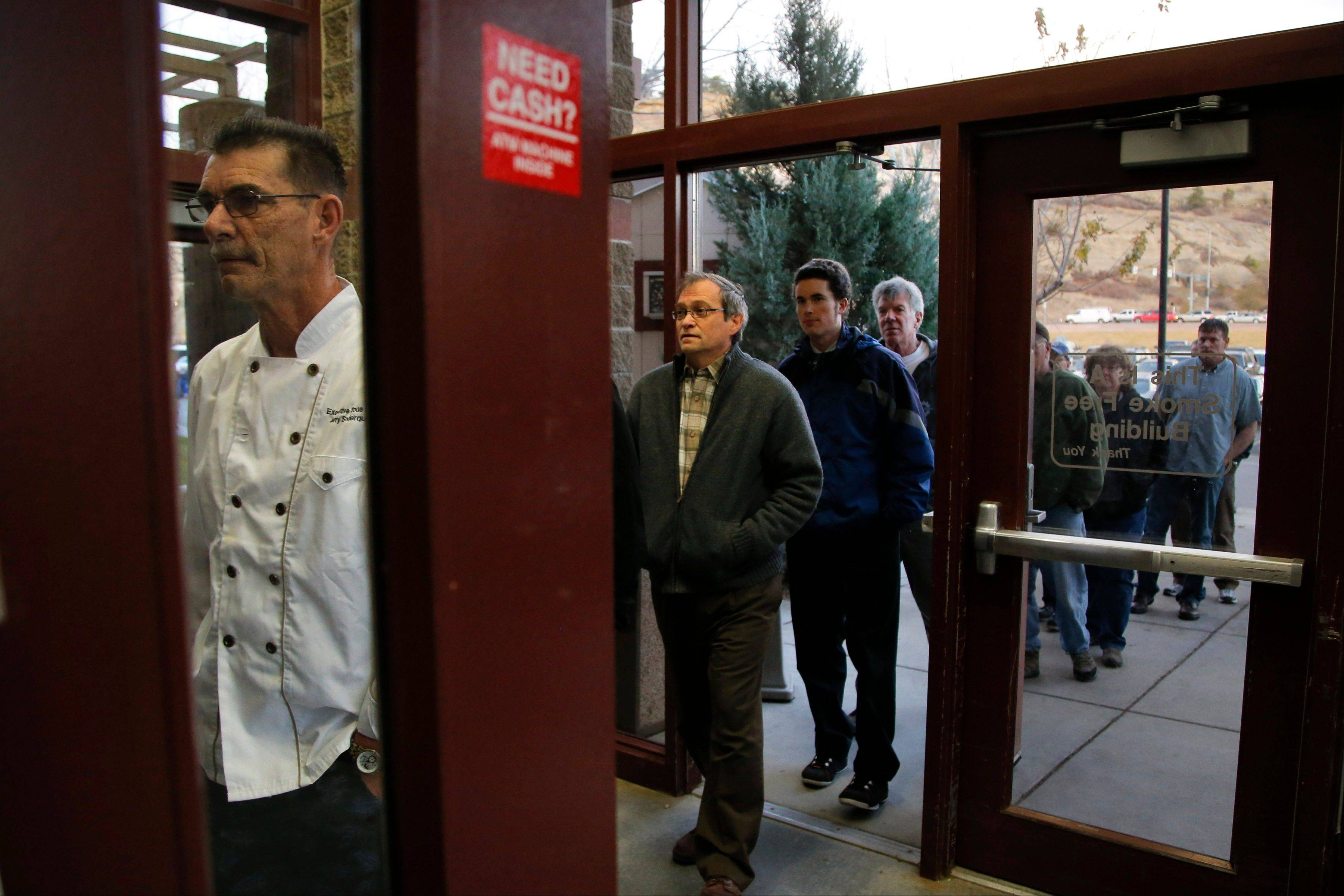 Voters wait in line to vote at a polling place on Election Day in Billings, Mont., Tuesday, Nov. 6, 2012.