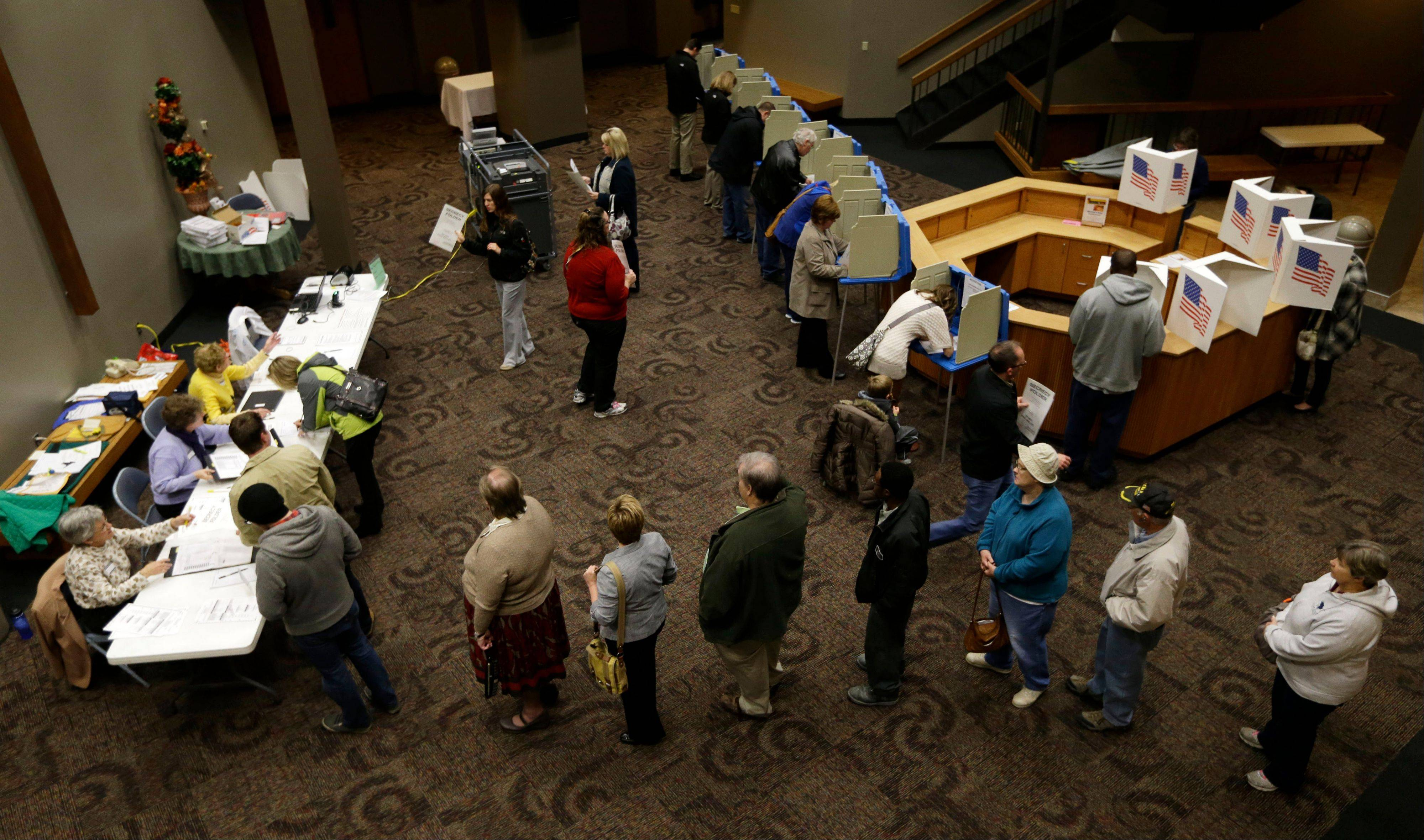 Voters in Precinct 39 wait in line for their ballots before casting their vote on Election Day, Tuesday, Nov. 6, 2012, at the First Church of the Open Bible in Des Moines, Iowa.