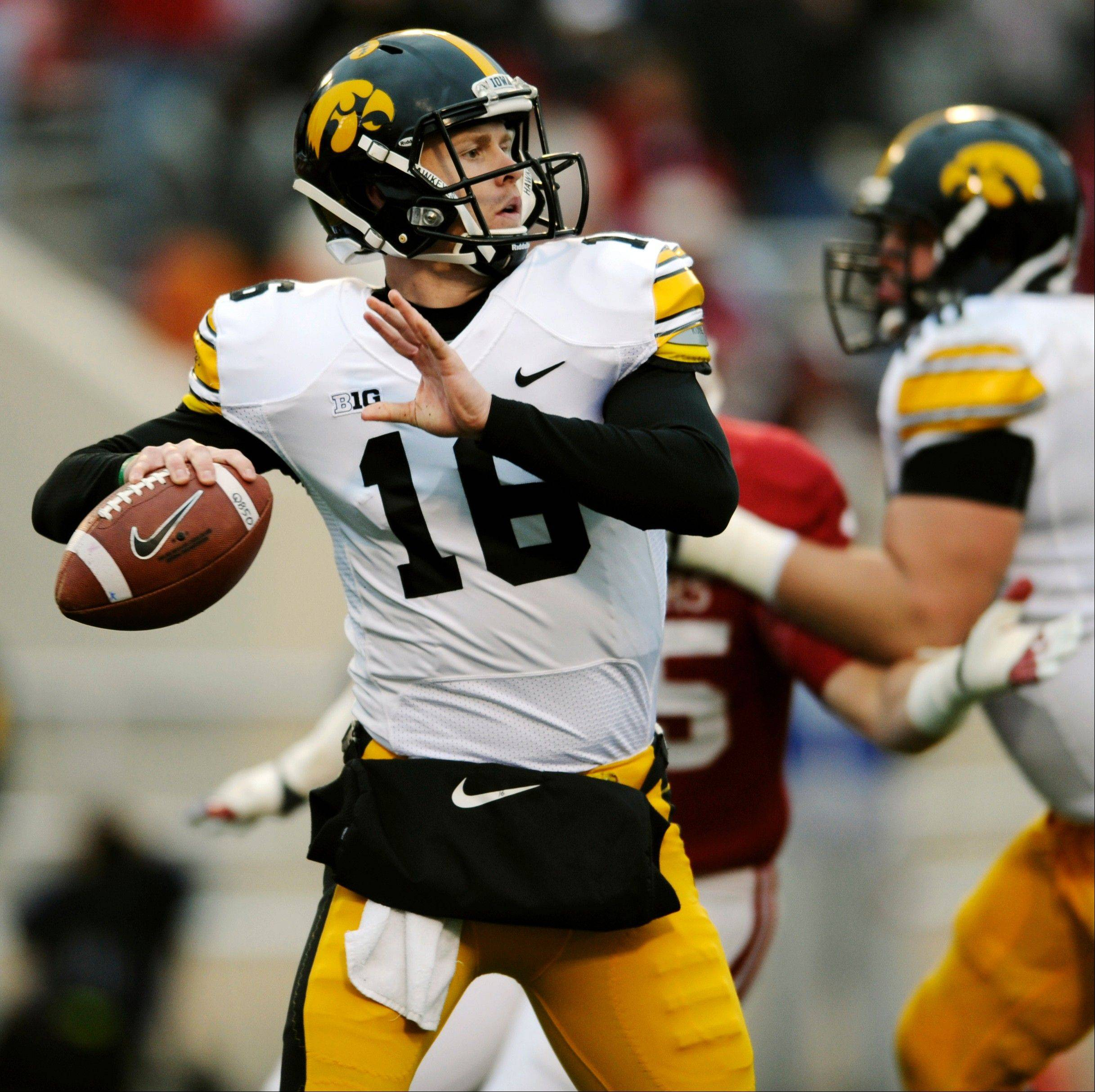 Iowa quarterback James Vandenberg looks to throw Saturday against Indiana in Bloomington, Ind.