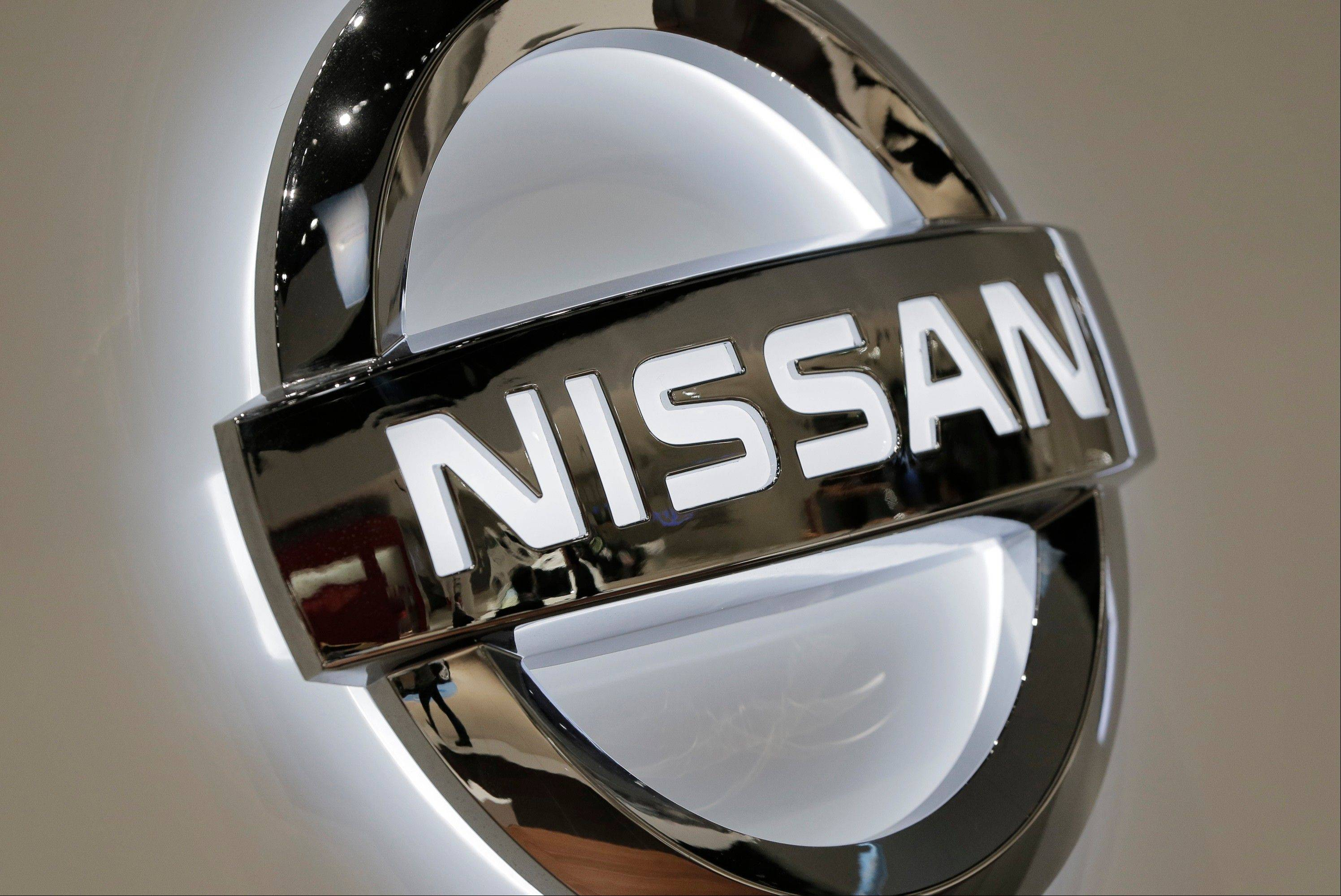 Nissan's quarterly profit rose nearly 8 percent, but the Japanese automaker lowered its full-year forecasts Tuesday because of a sales slump in China and weakness in Europe.