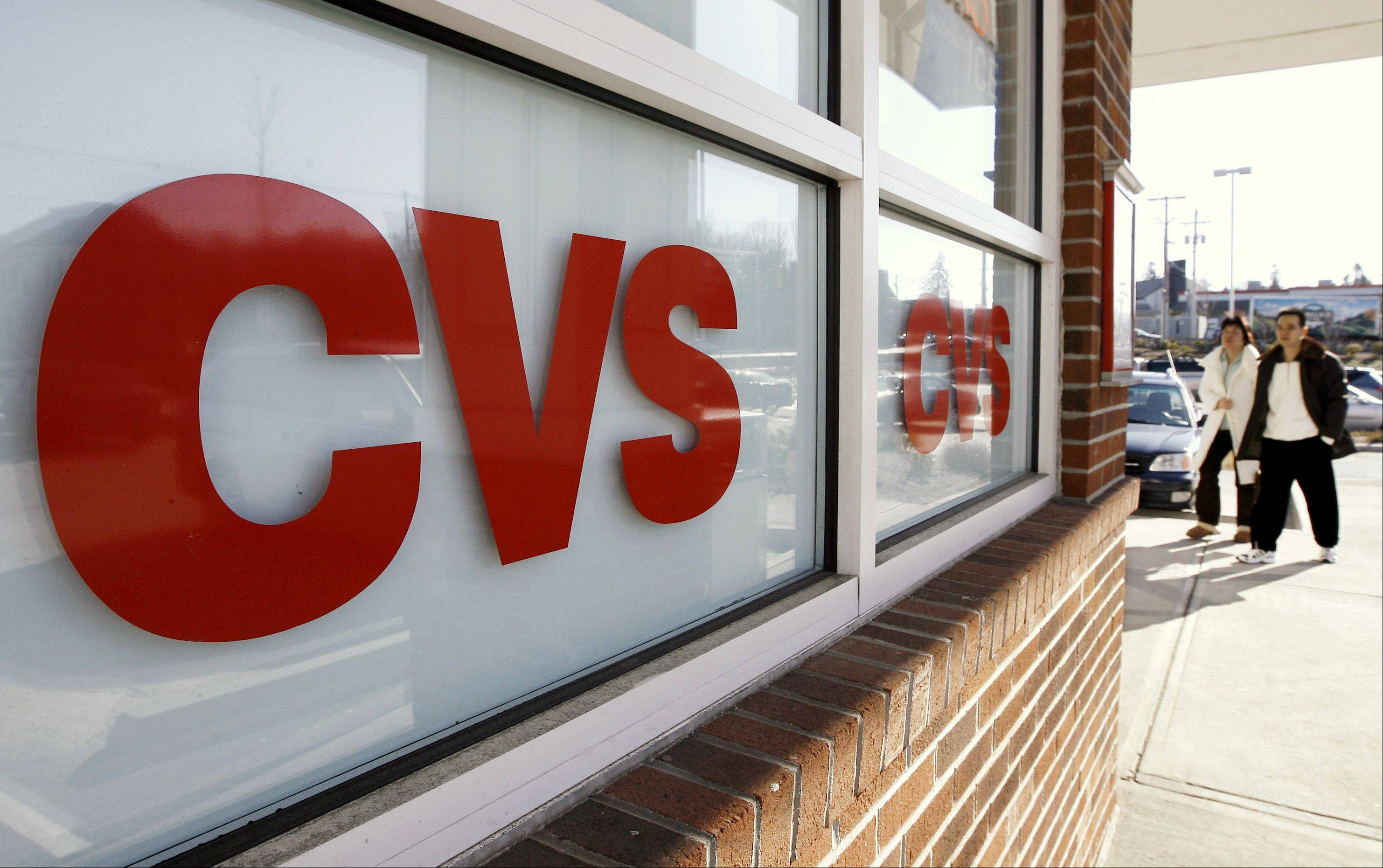 CVS Caremark says its third-quarter earnings climbed 16 percent. The drugstore operator and pharmacy benefits manager posted revenue increases in both businesses. The company also raised its full-year earnings outlook.