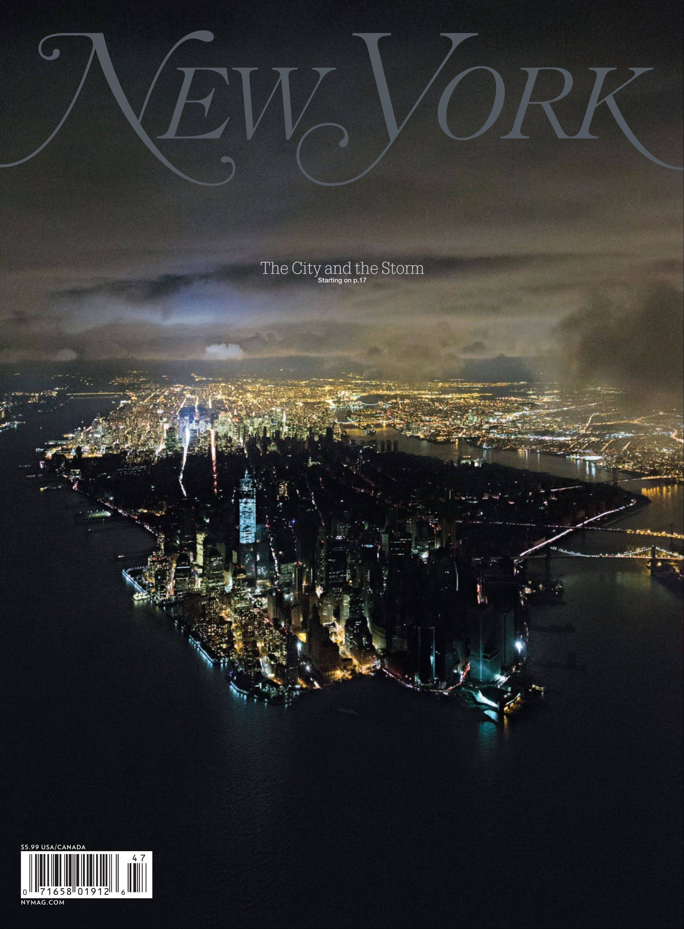 New York Magazine's cover features a photo taken by Iwan Baan on Wednesday, Oct. 31, showing New York City's Manhattan borough, half aglow and half in dark, after Superstorm Sandy slammed into the East Coast and morphed into a huge and problematic system, causing power outages for about 8.5 million.