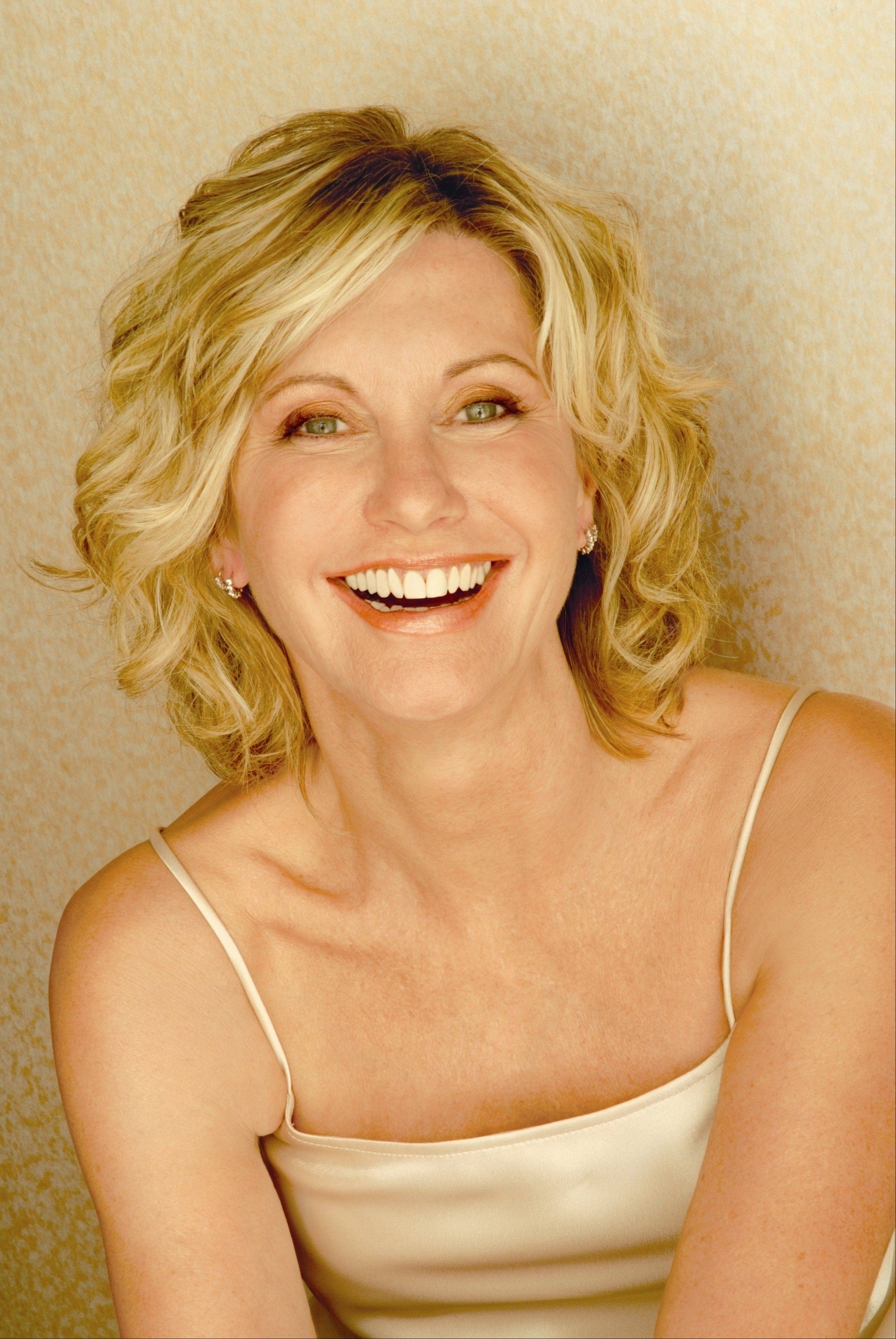 "Pop music icon Olivia Newton-John is performing a concert Saturday at Aurora's Paramount Theatre and could be singing some songs from the new CD she made with her ""Grease"" co-star John Travolta."