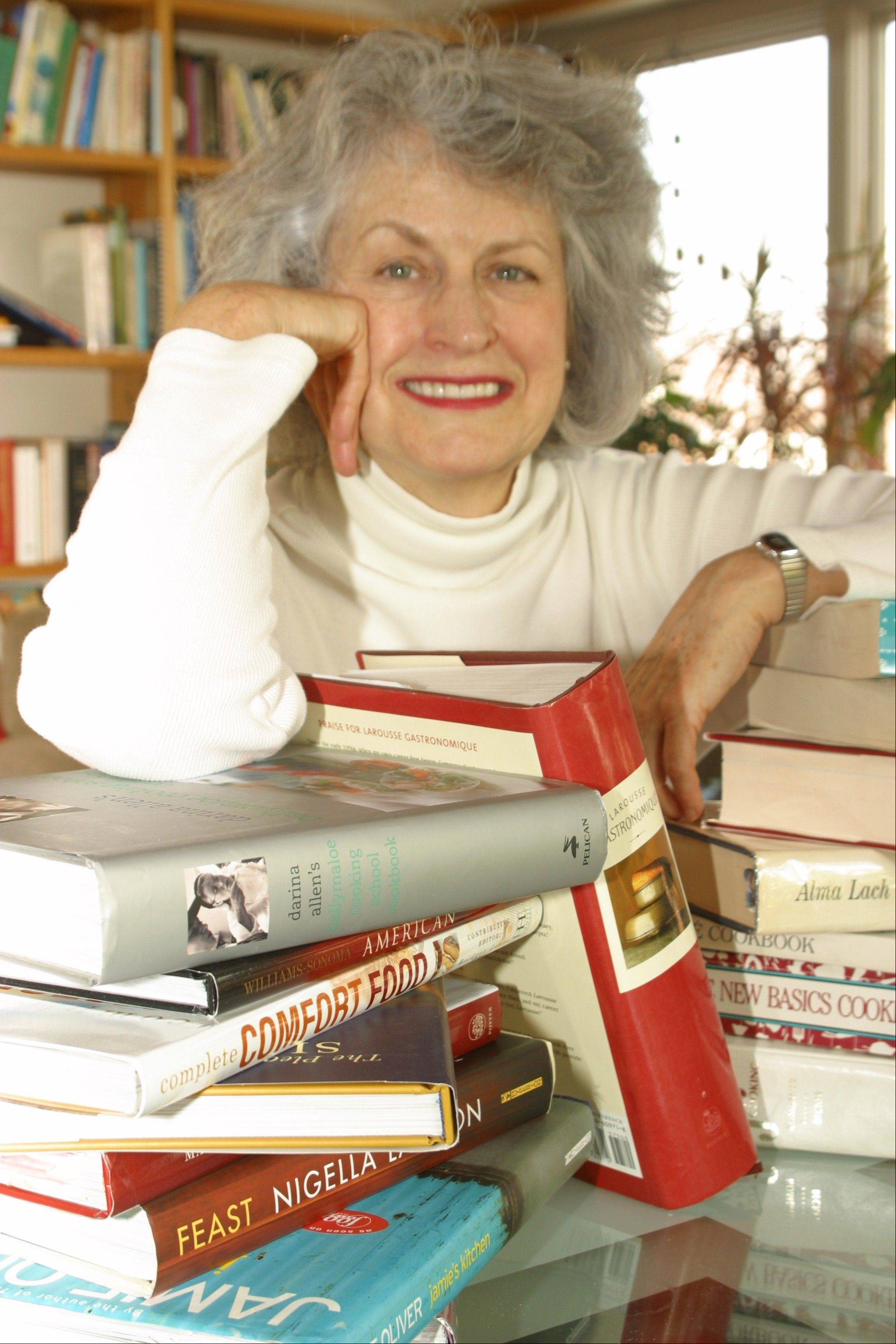 Food historian and cookbook collector Penelope Bingham shows some of the more than 2,000 cookbooks she owns.