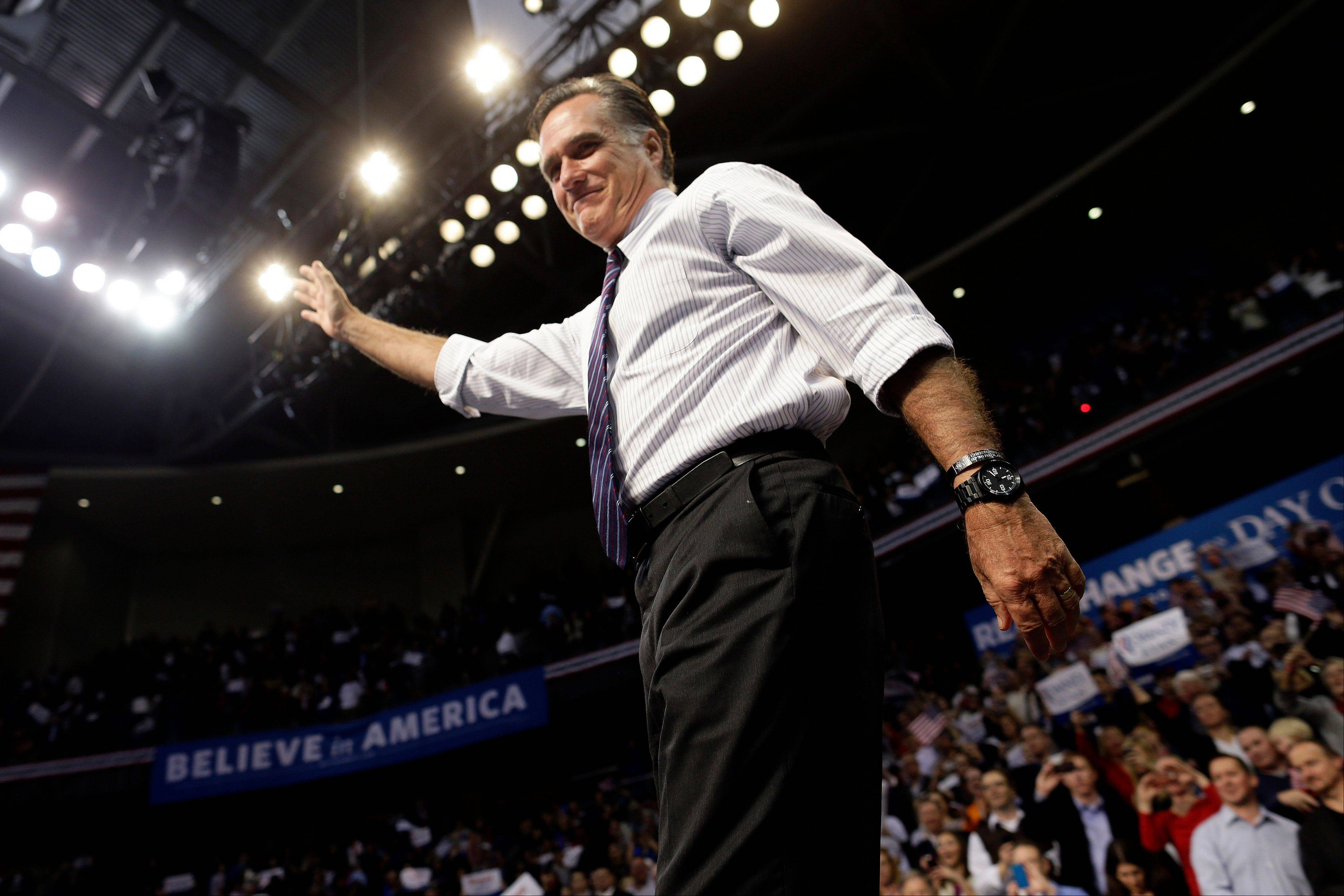 Republican presidential candidate and former Massachusetts Gov. Mitt Romney waves at the end of a New Hampshire campaign rally at Verizon Wireless Arena in Manchester, N.H., Monday.