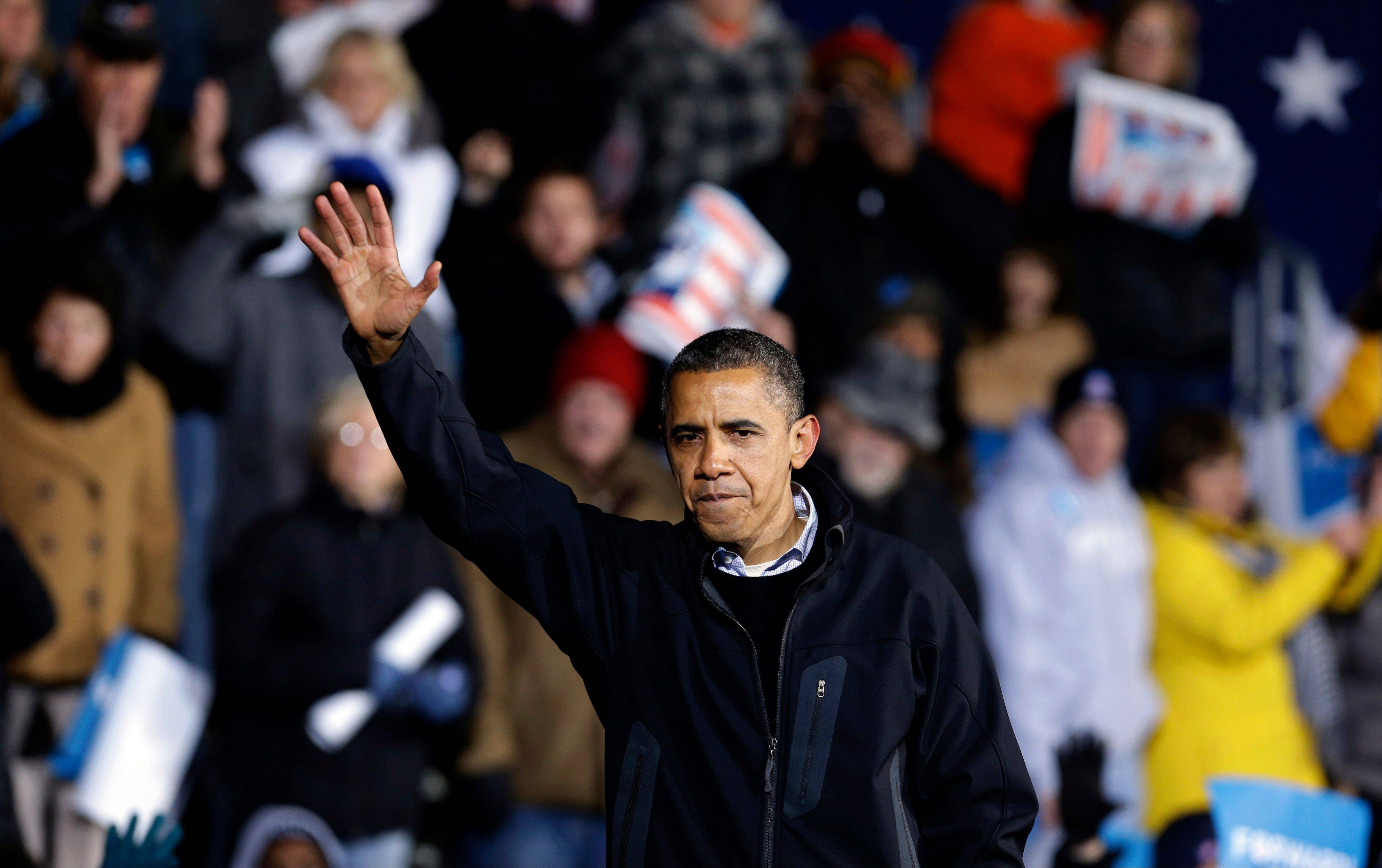 President Barack Obama waves to supporters after speaking at his final campaign stop on the evening before the 2012 election, Monday in Des Moines, Iowa.