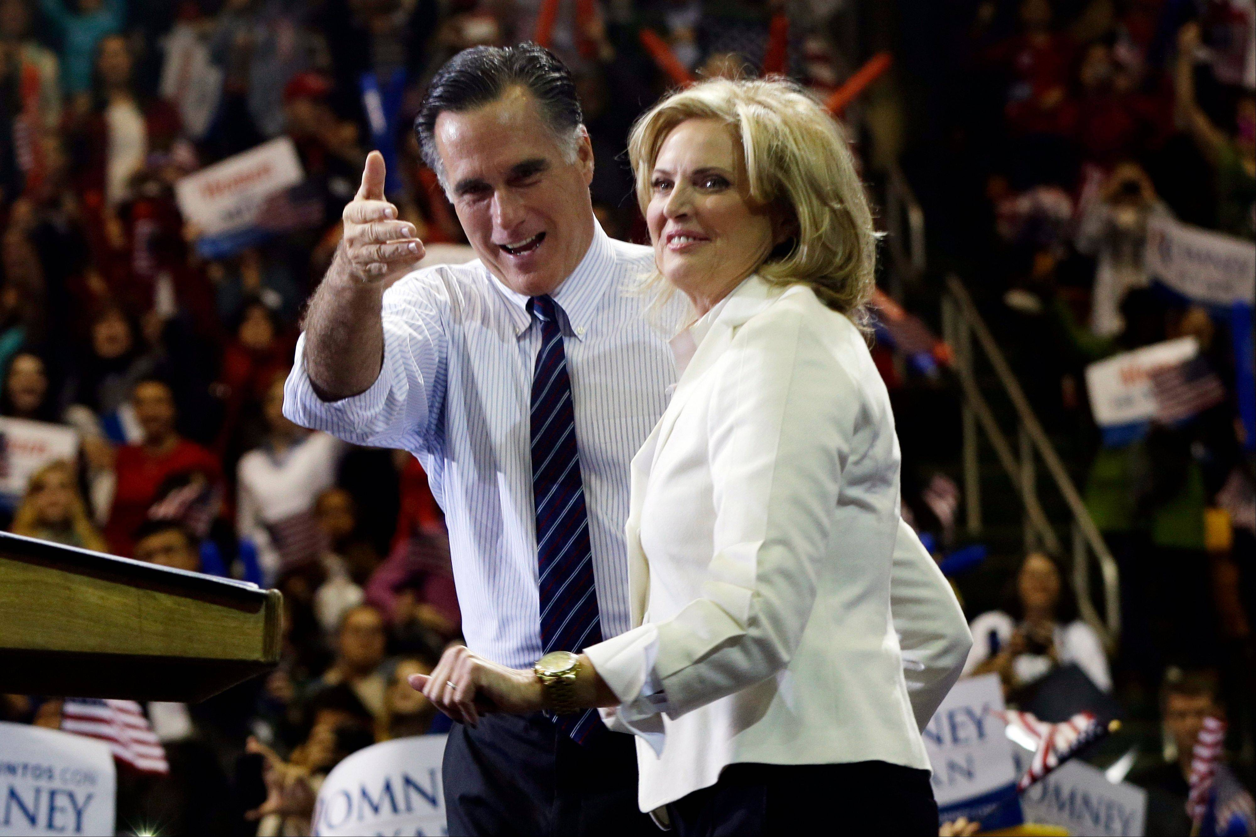 Republican presidential candidate and former Massachusetts Gov. Mitt Romney and wife Ann Romney stand onstage at a campaign rally at The Patriot Center at George Mason University in Fairfax, Va., Monday.