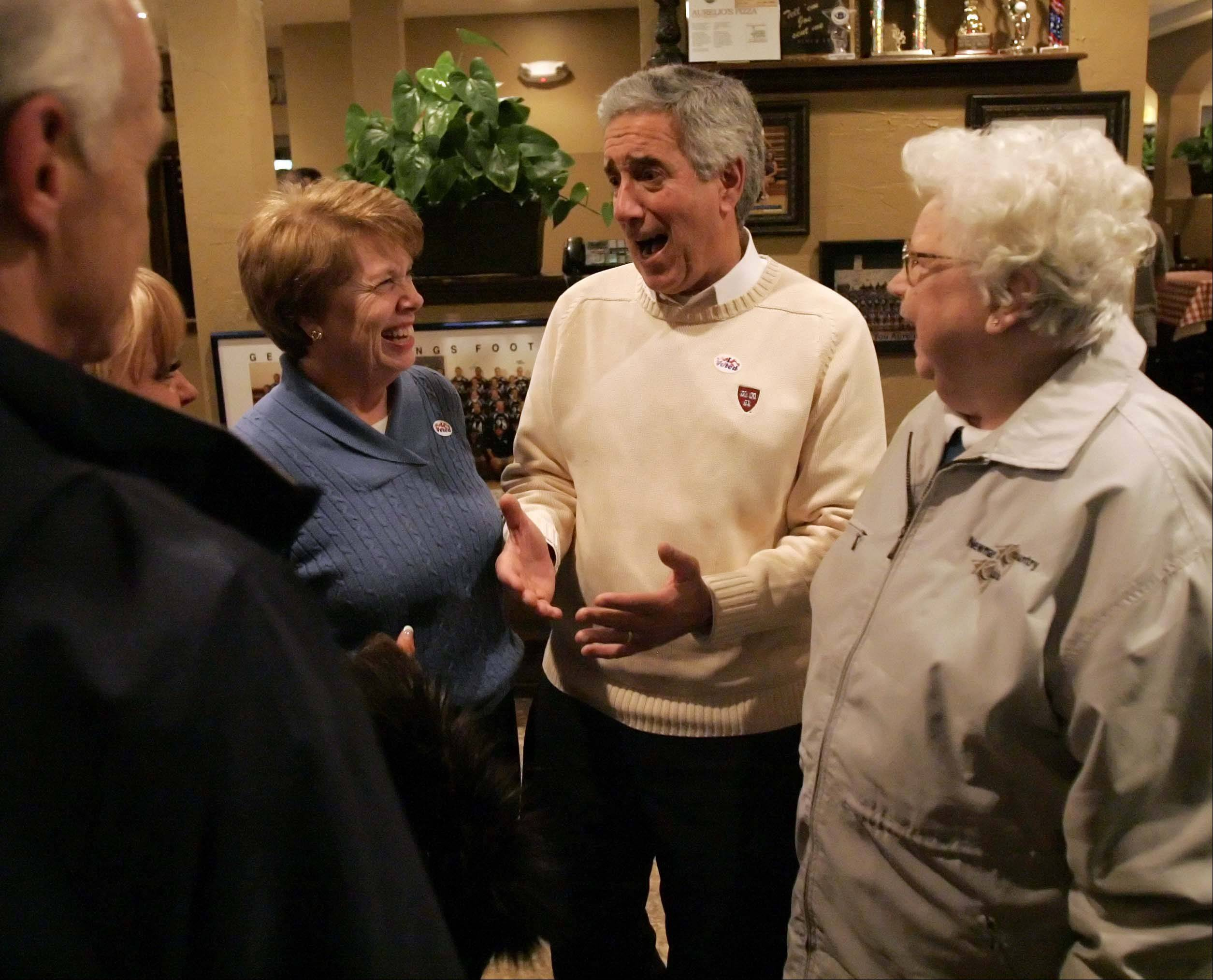 Chris Lauzen talks with his wife Sarah, left, and other supporters, including Donna Neely, right, of Elburn as he gets the good news Tuesday that he will be the new Kane County Board chairman. Lauzen defeated Sue Klinkhamer, according to unofficial results.