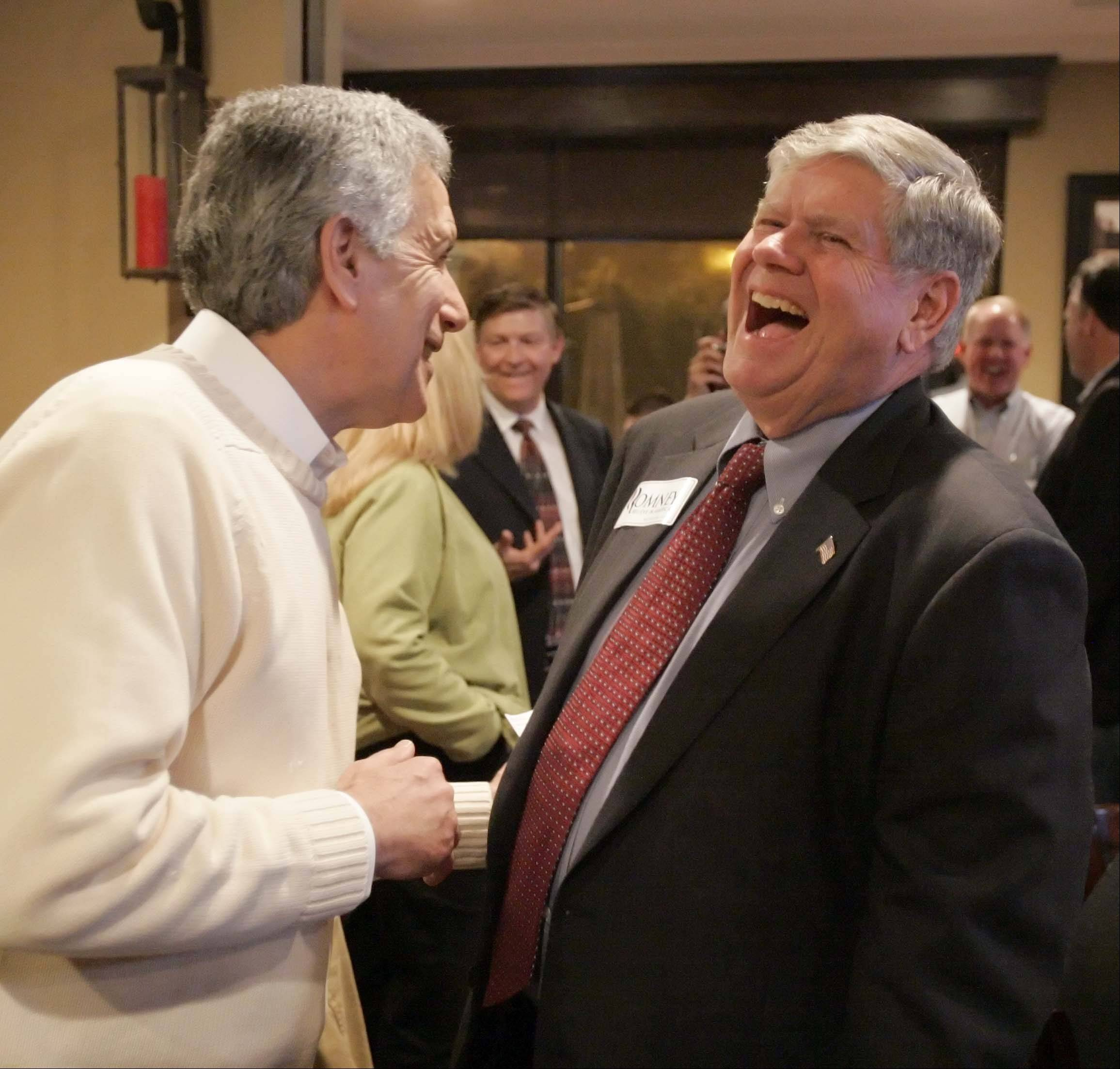 Kane County Board Chairman-elect Chris Lauzen of Aurora shares a laugh with Jim Oberweis of Sugar Grove Tuesday as election results flow in at a Kane County Republican Party in Geneva. Oberweis was elected state senator in the 25th District, according to unofficial results.