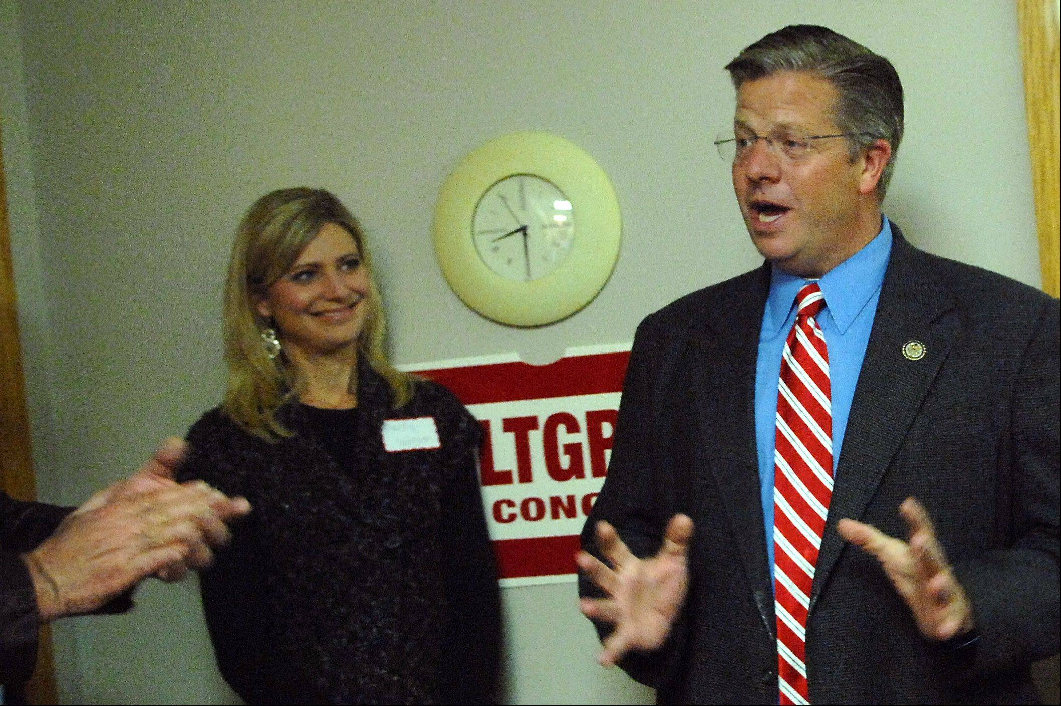 With his wife Christy looking on, Congressman Randy Hultgren thanks his supporters at his campaign headquarters in St. Charles Tuesday night after presumably winning re-election.