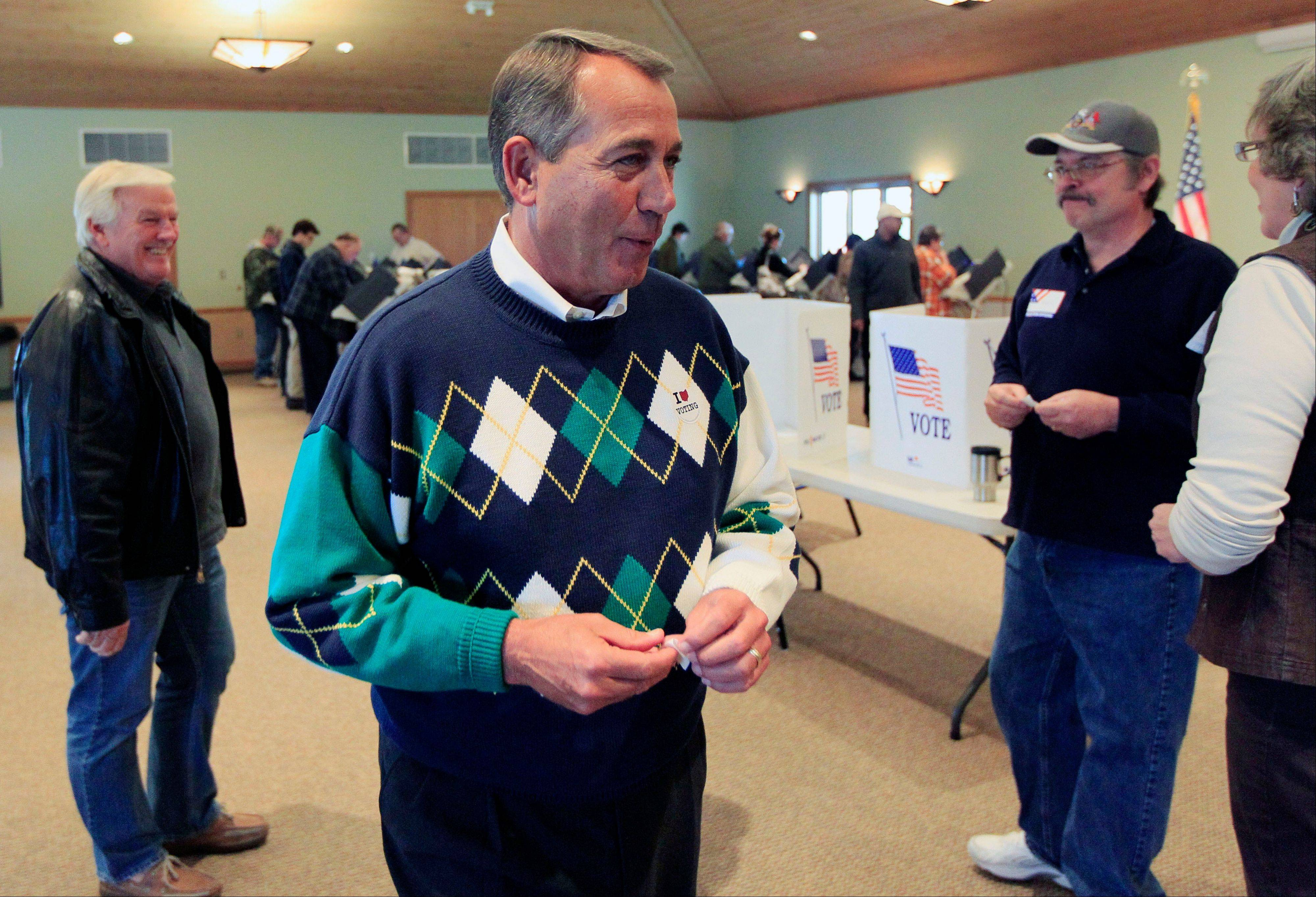 GOP House Speaker John Boehner of Ohio talks with poll workers after voting at Ronald Reagan Lodge, in West Chester, Ohio.