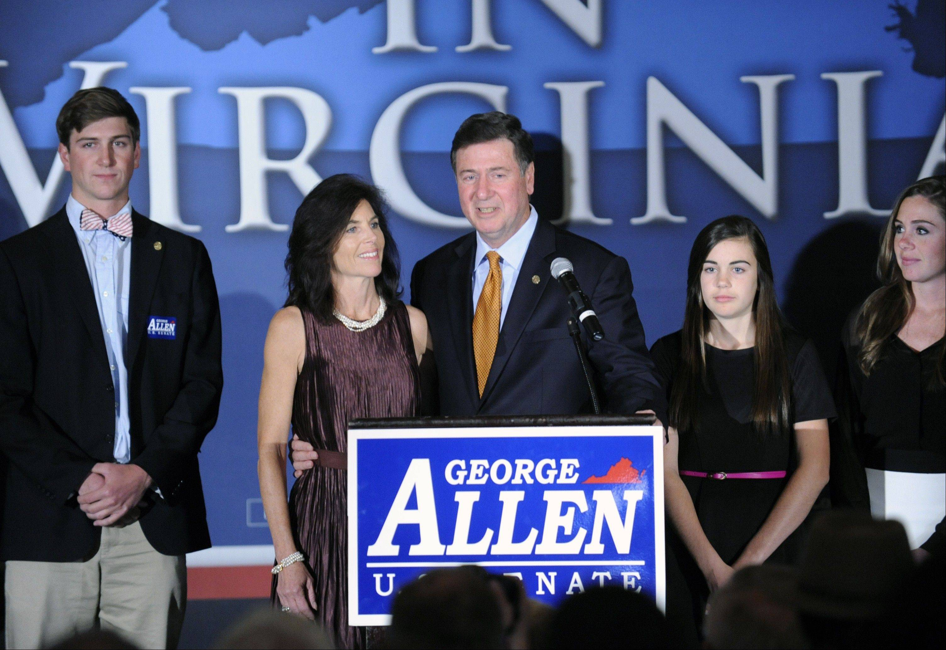 George Allen, with his family at his side, addresses supporters after conceding at the Republican Party of Virginia post election event at the Omni Hotel in Richmond, Va.