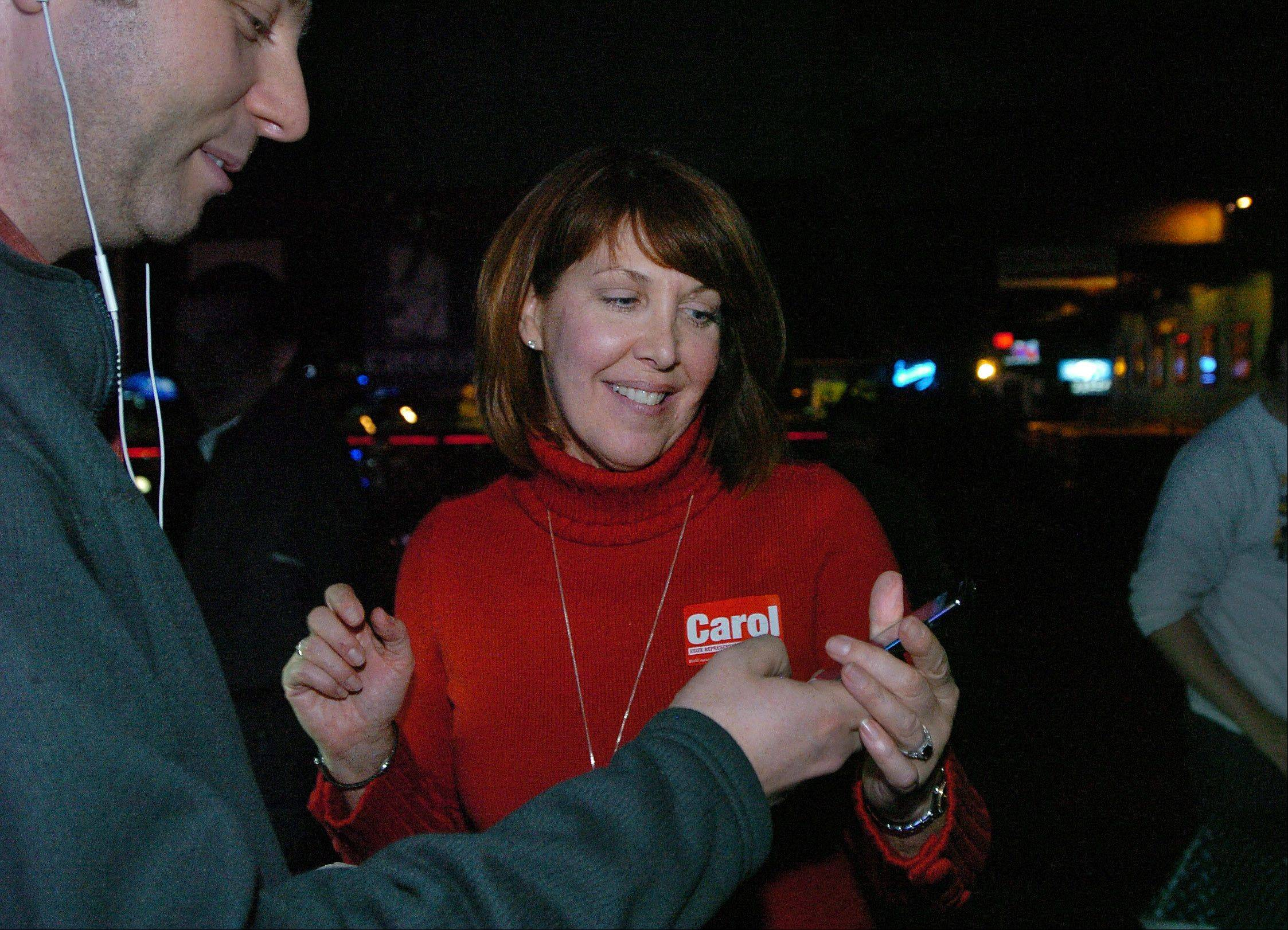 Carol Sente of Vernon Hills gets good news from her campaign manager Andrew Chusid as she wins her race against Sidney Mathias of Buffalo Grove in the 59th House district.