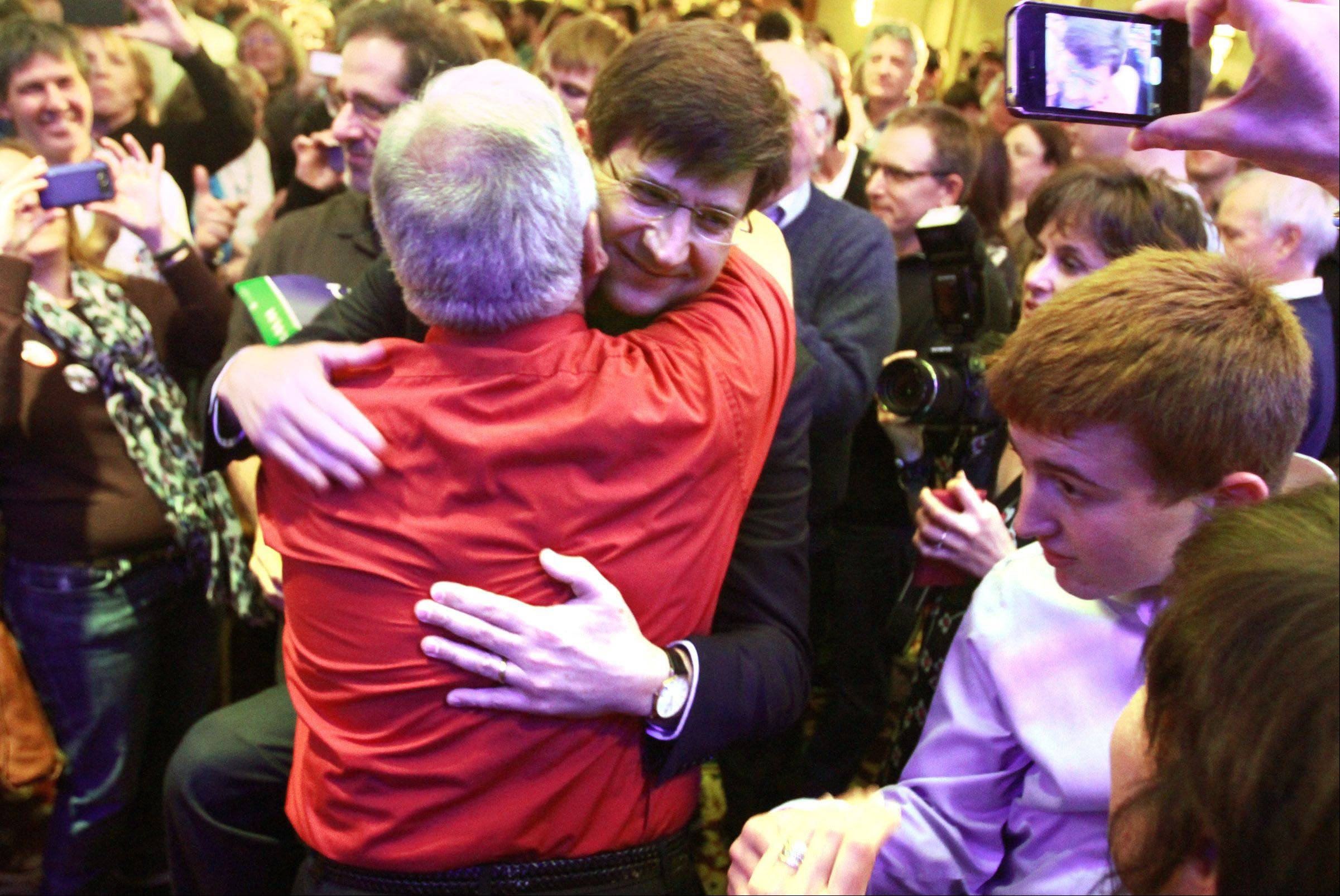 Brad Schneider gets a hug from a supporter as he takes the stage in Northbrook after winning the Illinois' 10th Congressional District on Tuesday.