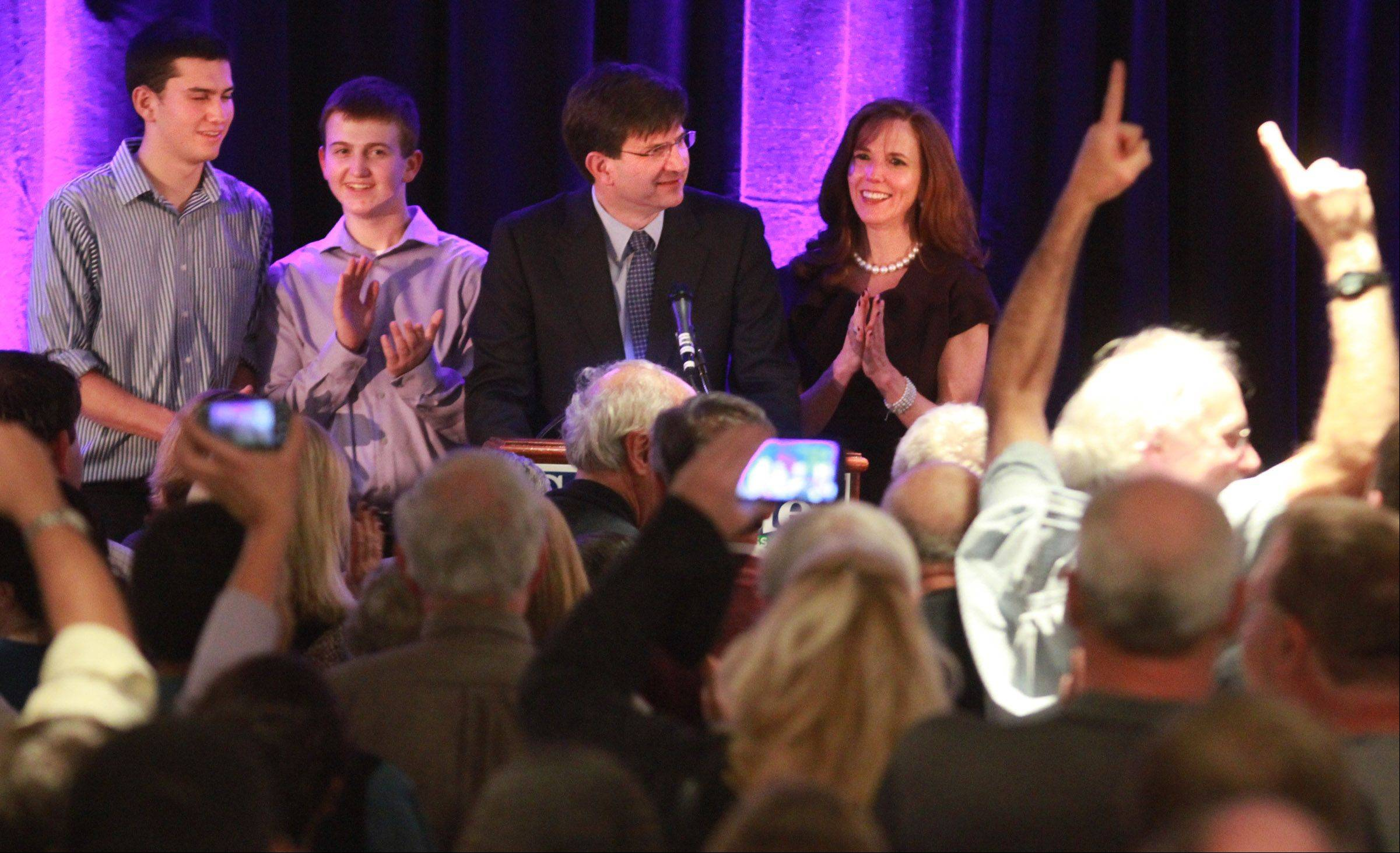 Brad Schneider, with his wife Julie Dann and his sons Adam and Daniel Schneider next to him, speaks to supporters in Northbrook after winning the Illinois' 10th Congressional District.