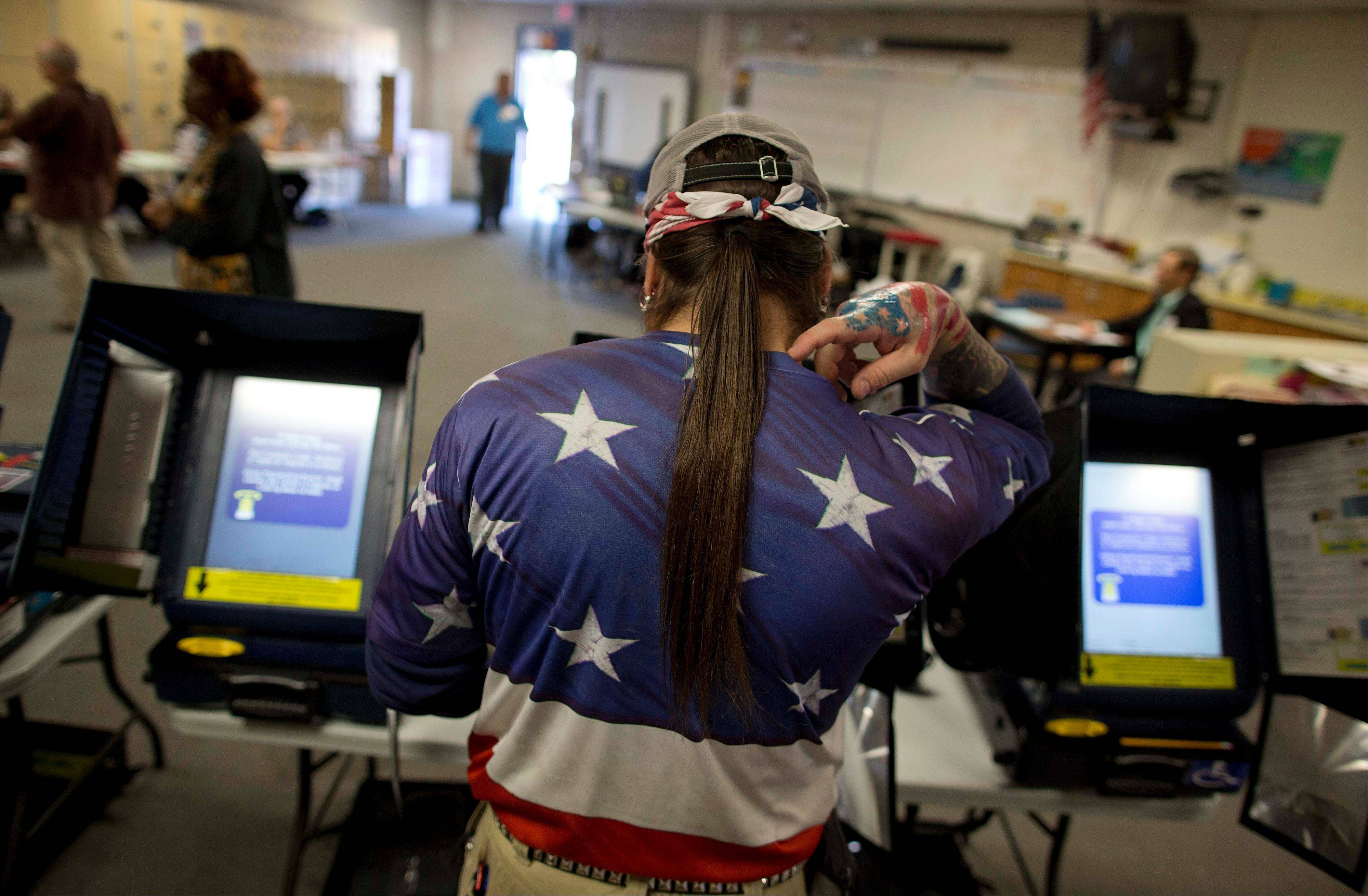 "Victor ""Snake Mann"" Wolder, marks his choices while voting during Election Day, Tuesday, Nov. 6, 2012, in Las Vegas."