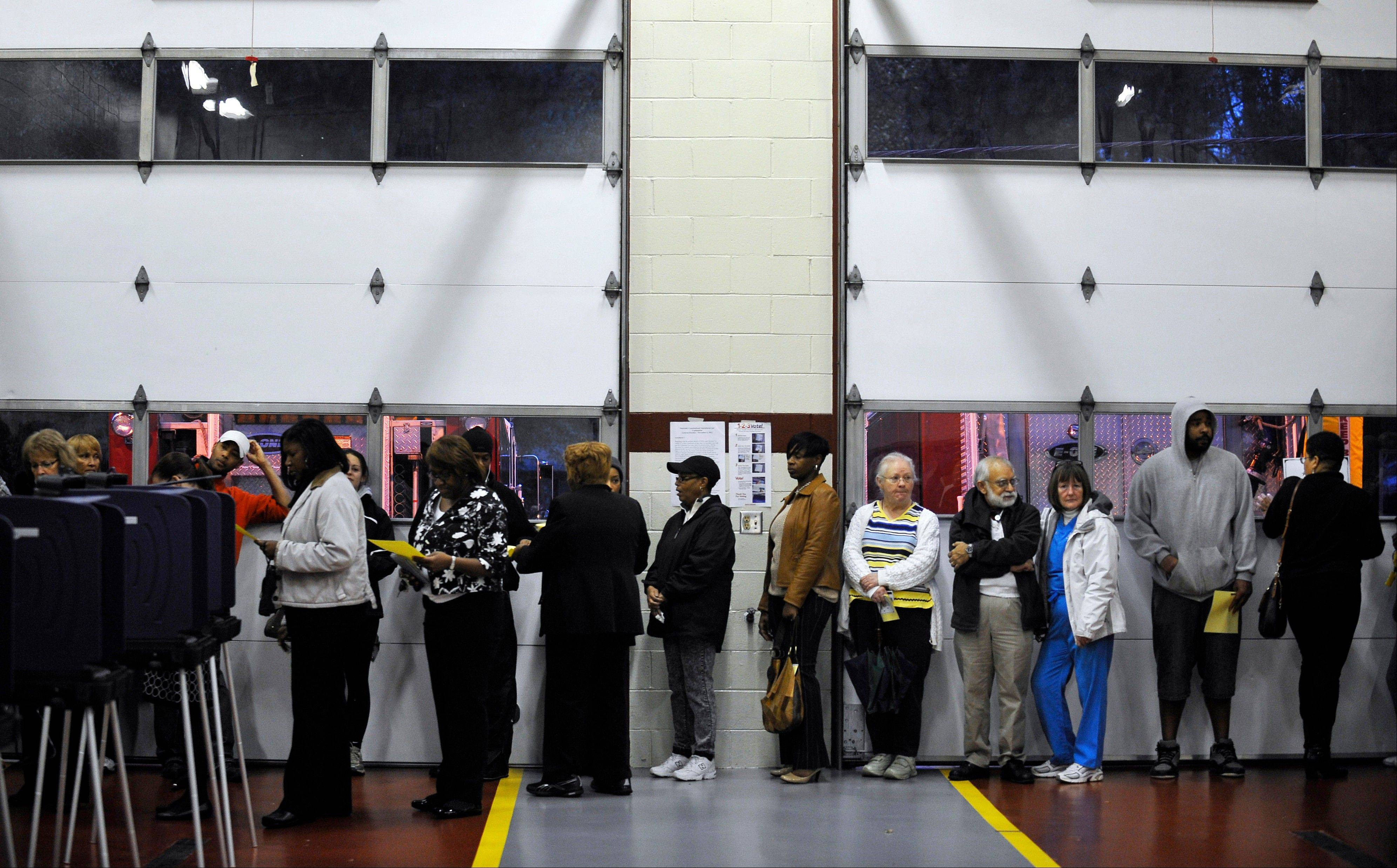 Voters wait in line to cast their ballots at the Mauldin Fire Station on Election Day, Tuesday, Nov. 6, 2012, in Mauldin, S.C.