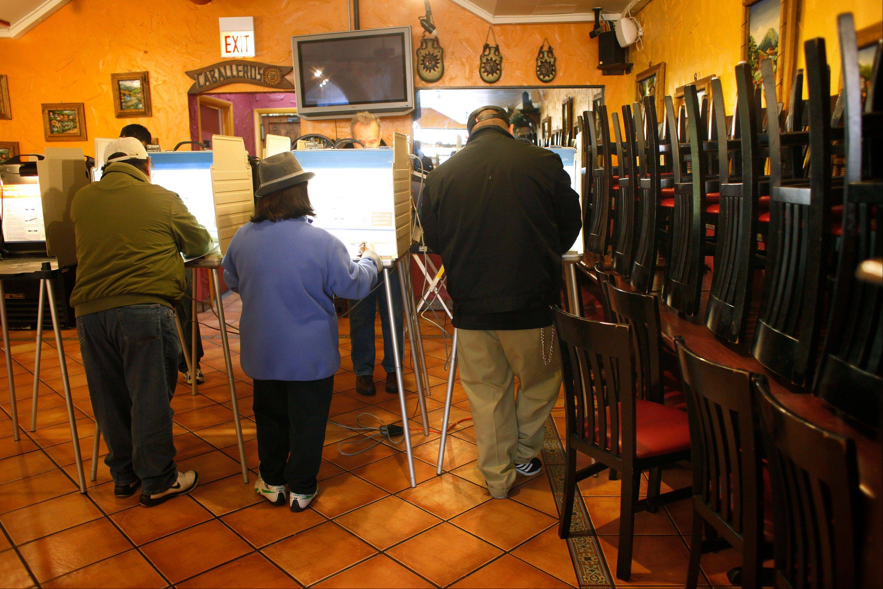 Voters cast their ballots in a Mexican restaurant turned polling place, on election day on the South Side of Chicago Tuesday Nov. 6, 2012.