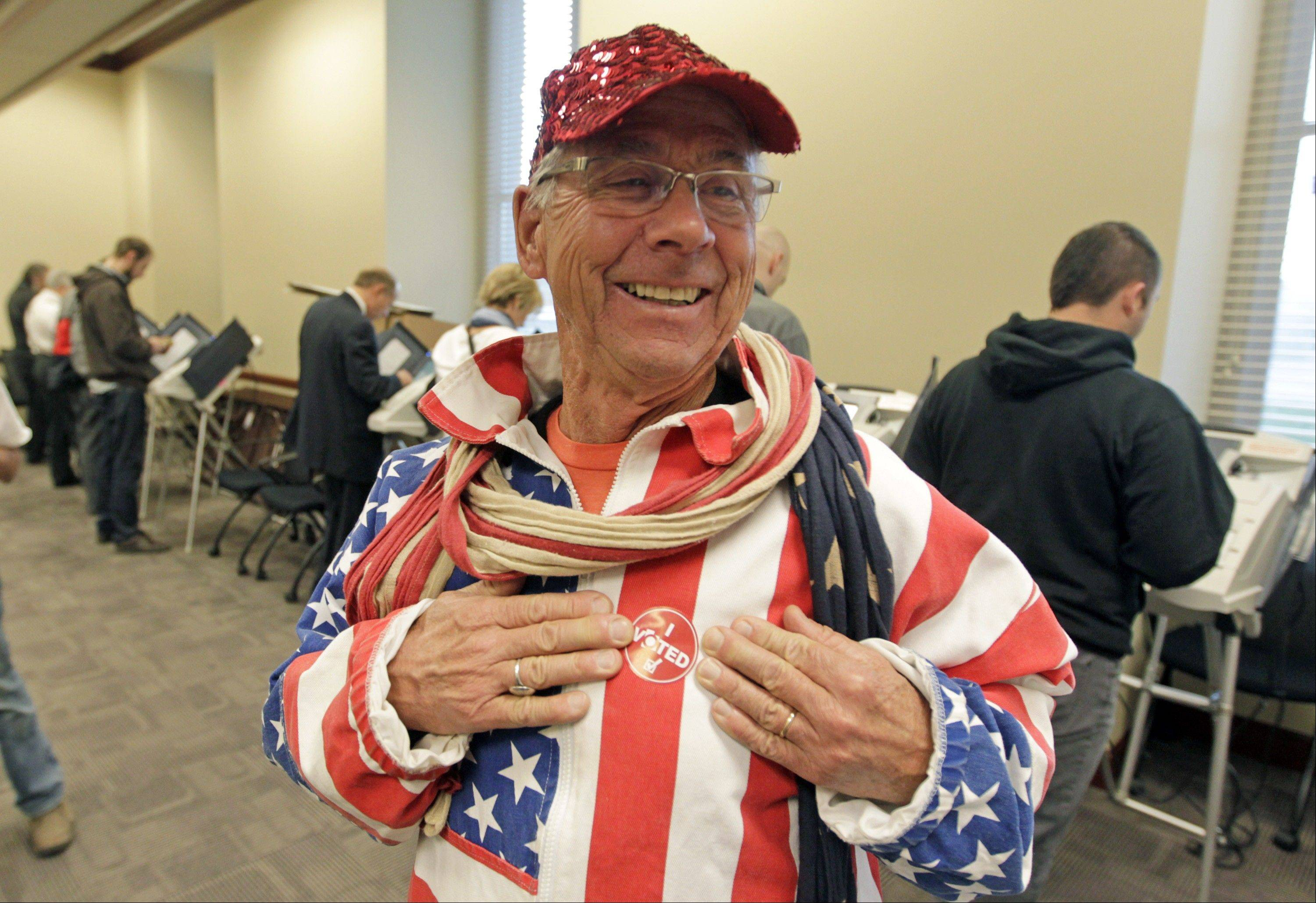 Mark Jensen, 66, dressed as a flag, displays his I voted sticker after voting at the Utah State Capitol Tuesday, Nov. 6, 2012, in Salt Lake City.